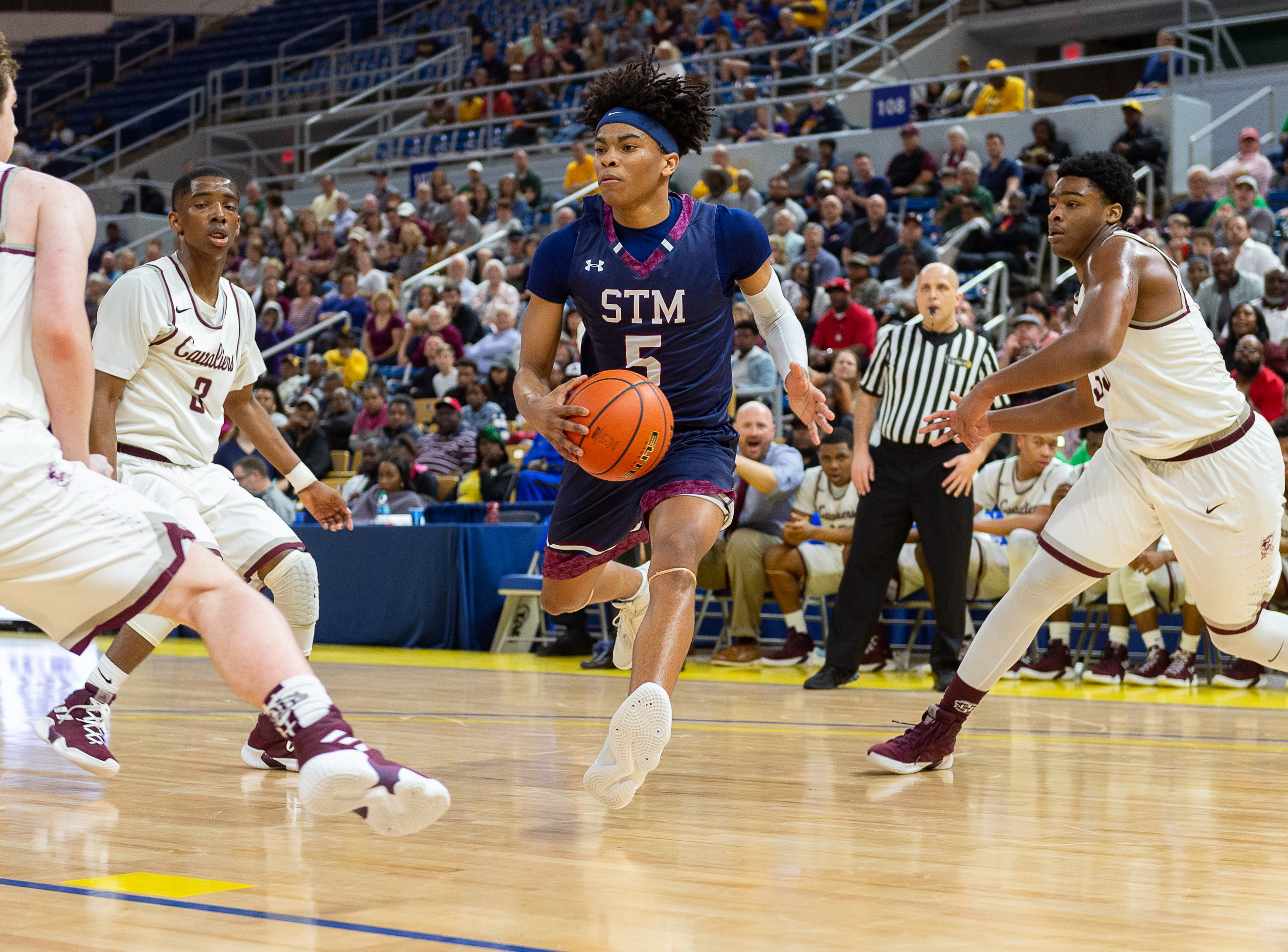 Jaden Shelvin drives to the basket as The STM Cougars beat DeLaSalle in double overtime to win the Allstate Sugar Bowl/LHSAA Boys' Marsh Madness Div II State Championship. Saturday, March 9, 2019.