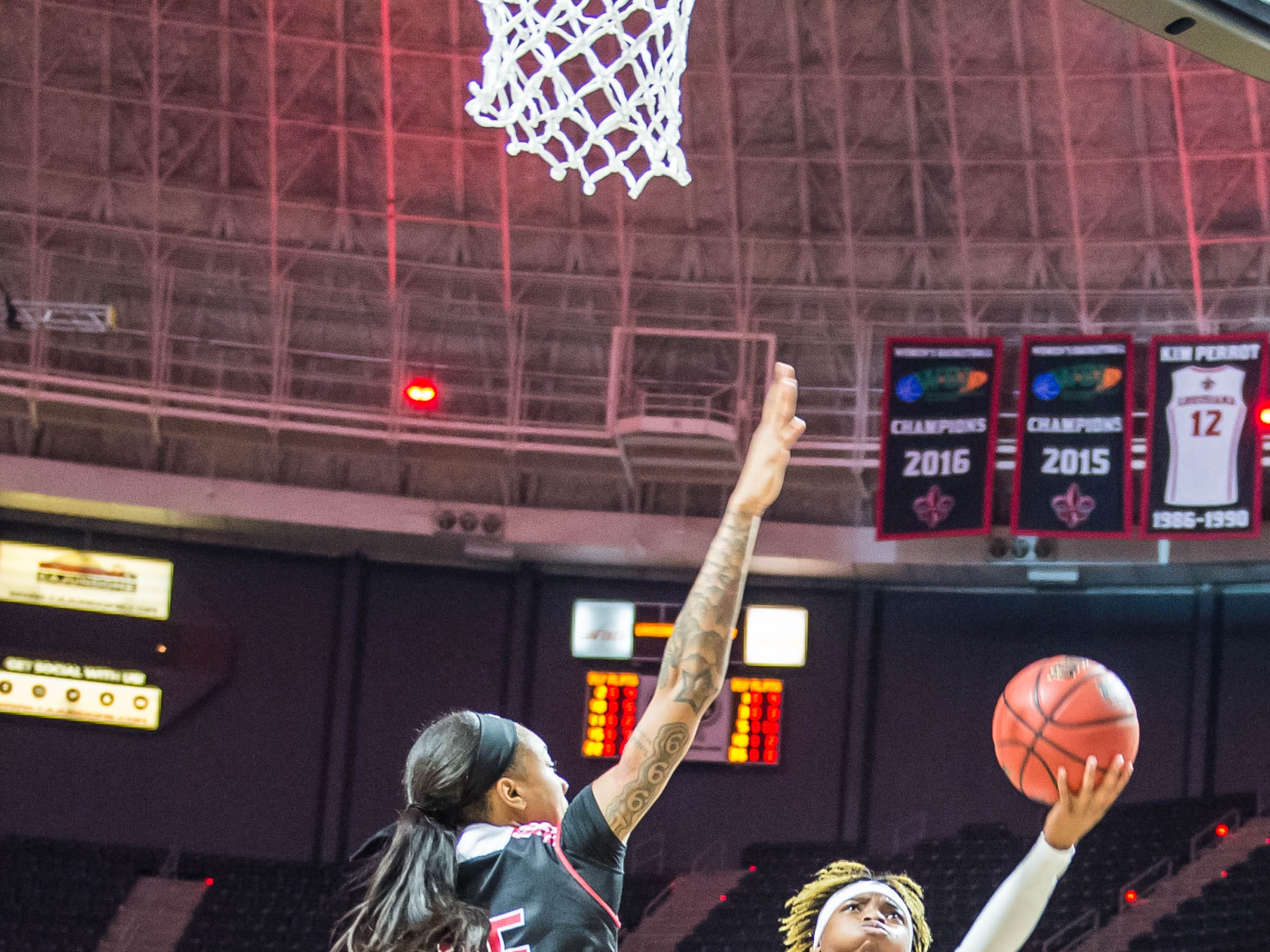 Cajuns guard Diamond Morrison (15) with the left handed layup as the Cajuns women's basketball team plays the Arkansas State Red Wolves at the Cajundome on Saturday, March 9, 2019.