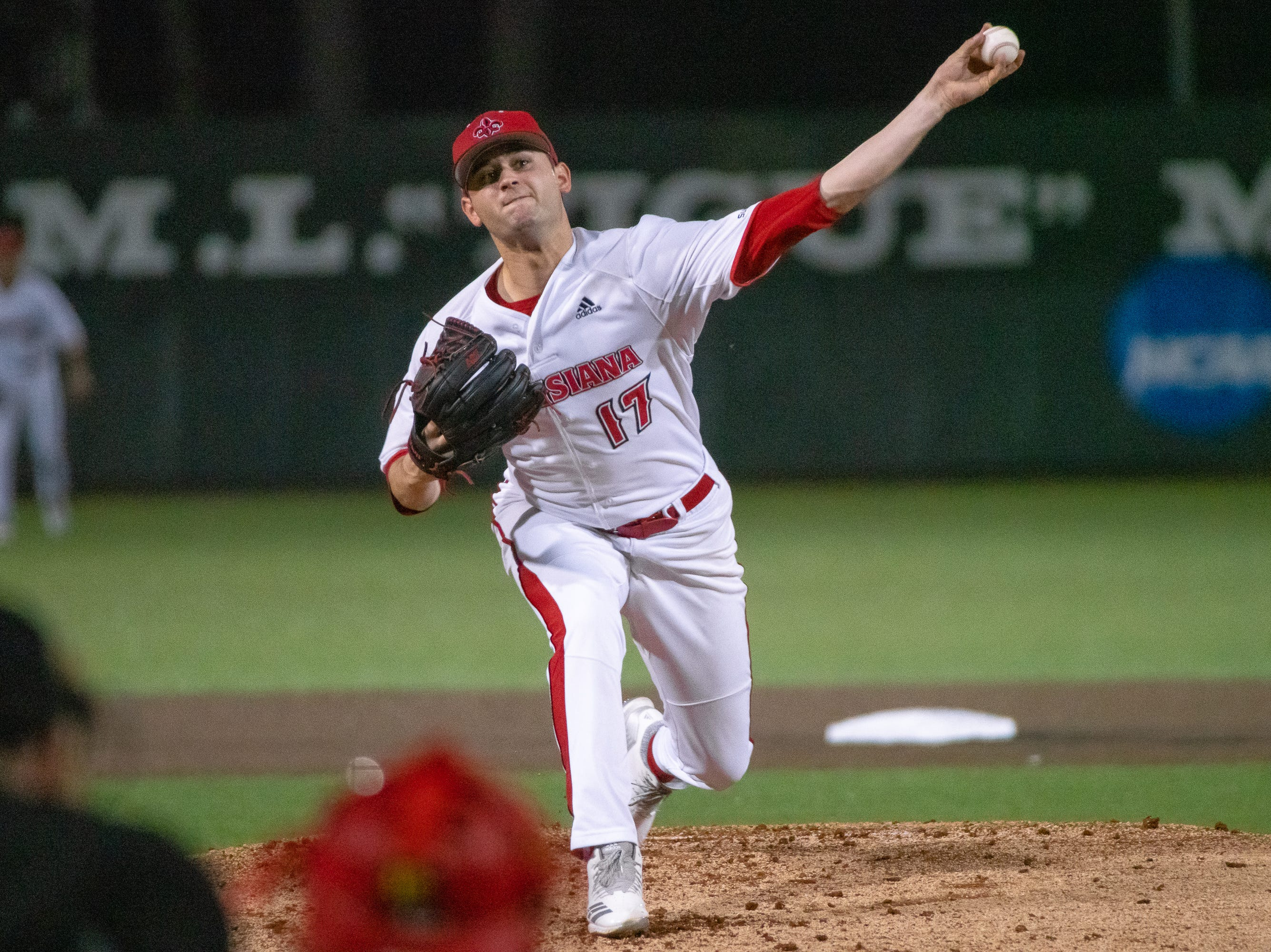 "UL's Gunner Leger pitches from the mound as the Ragin' Cajuns take on the Loyola Marymount Lions at M.L. ""Tigue"" Moore Field on Friday, March 8, 2019."