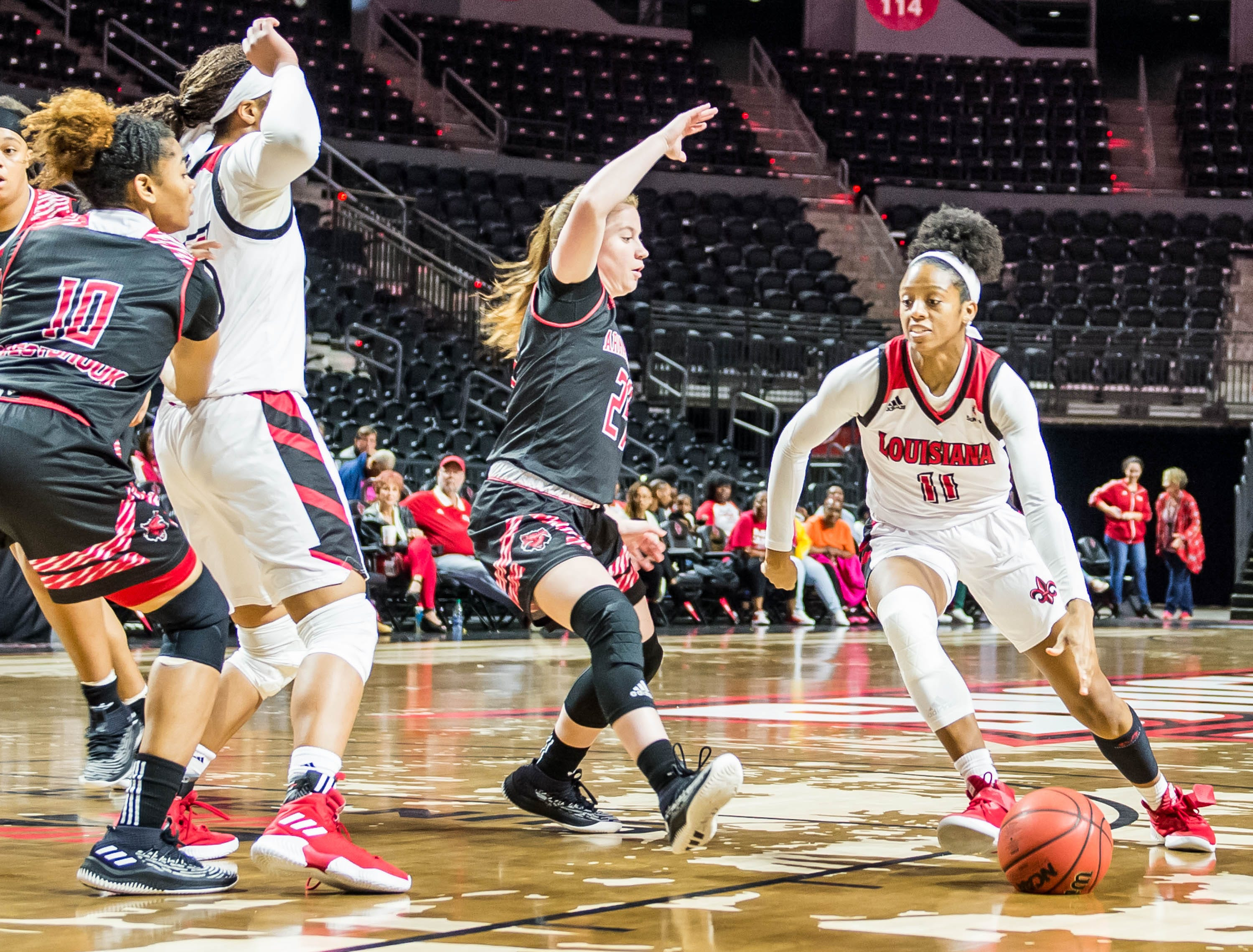 Cajuns Skyler Goodwin (11) takes the ball inside the paint as the Cajuns women's basketball team plays the Arkansas State Red Wolves at the Cajundome on Saturday, March 9, 2019.