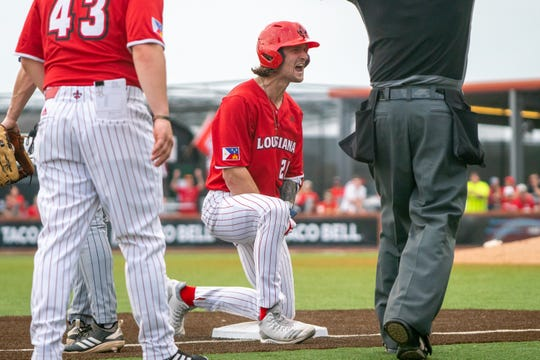 UL's Orynn Veillon shouts to his teammates in celebration on third base as the Ragin' Cajuns take on the Loyola-Marymount Lions at M.L. Tigue Moore Field on Saturday, March 9, 2019.