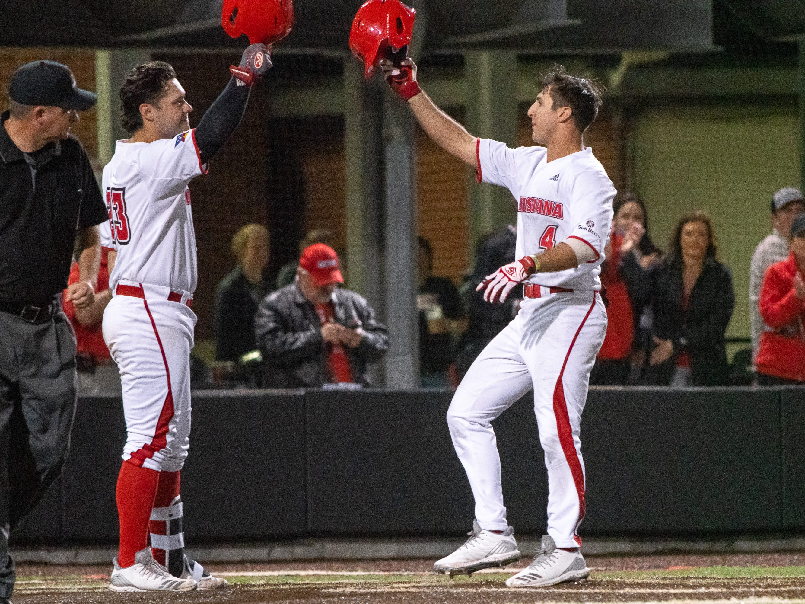 "UL's Handsome Monica (left) congratulates teammate Brennan Breaux (right) after his home run score as the Ragin' Cajuns take on the Loyola Marymount Lions at M.L. ""Tigue"" Moore Field on Friday, March 8, 2019."
