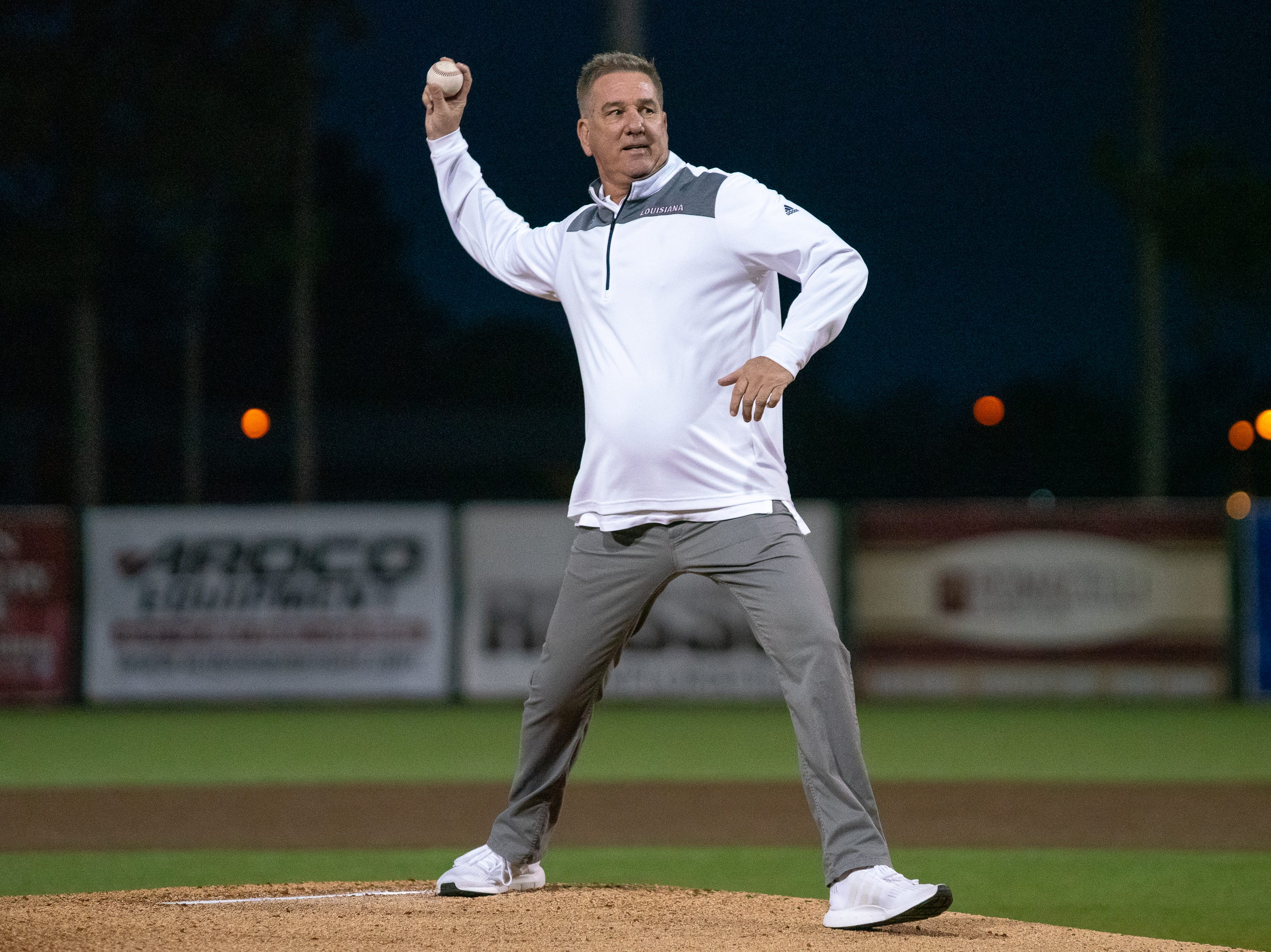 "UL head women's basketball coach Garry Brodhead throws out the first pitch as the Ragin' Cajuns take on the Loyola Marymount Lions at M.L. ""Tigue"" Moore Field on Friday, March 8, 2019."