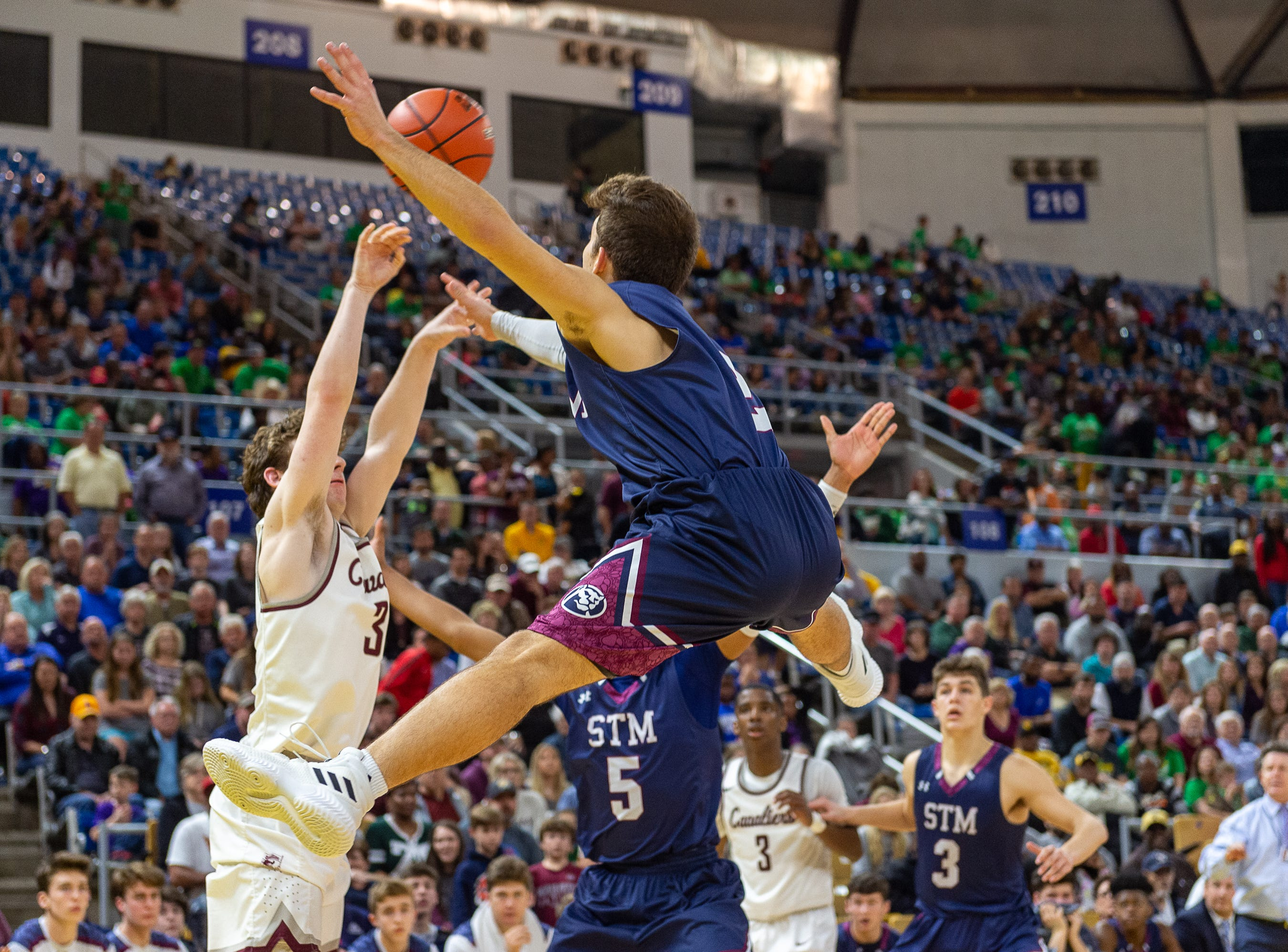 Grant Arceneaux on defense as The STM Cougars beat DeLaSalle in double overtime to win the Allstate Sugar Bowl/LHSAA Boys' Marsh Madness Div II State Championship. Saturday, March 9, 2019.