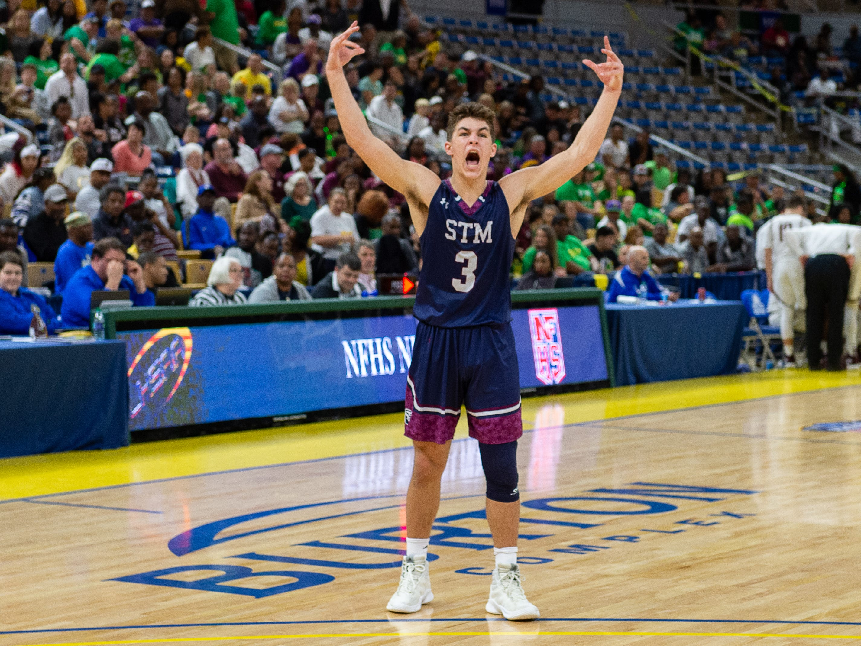 Carter Domingue pumps up the fans as The STM Cougars beat DeLaSalle in double overtime to win the Allstate Sugar Bowl/LHSAA Boys' Marsh Madness Div II State Championship. Saturday, March 9, 2019.