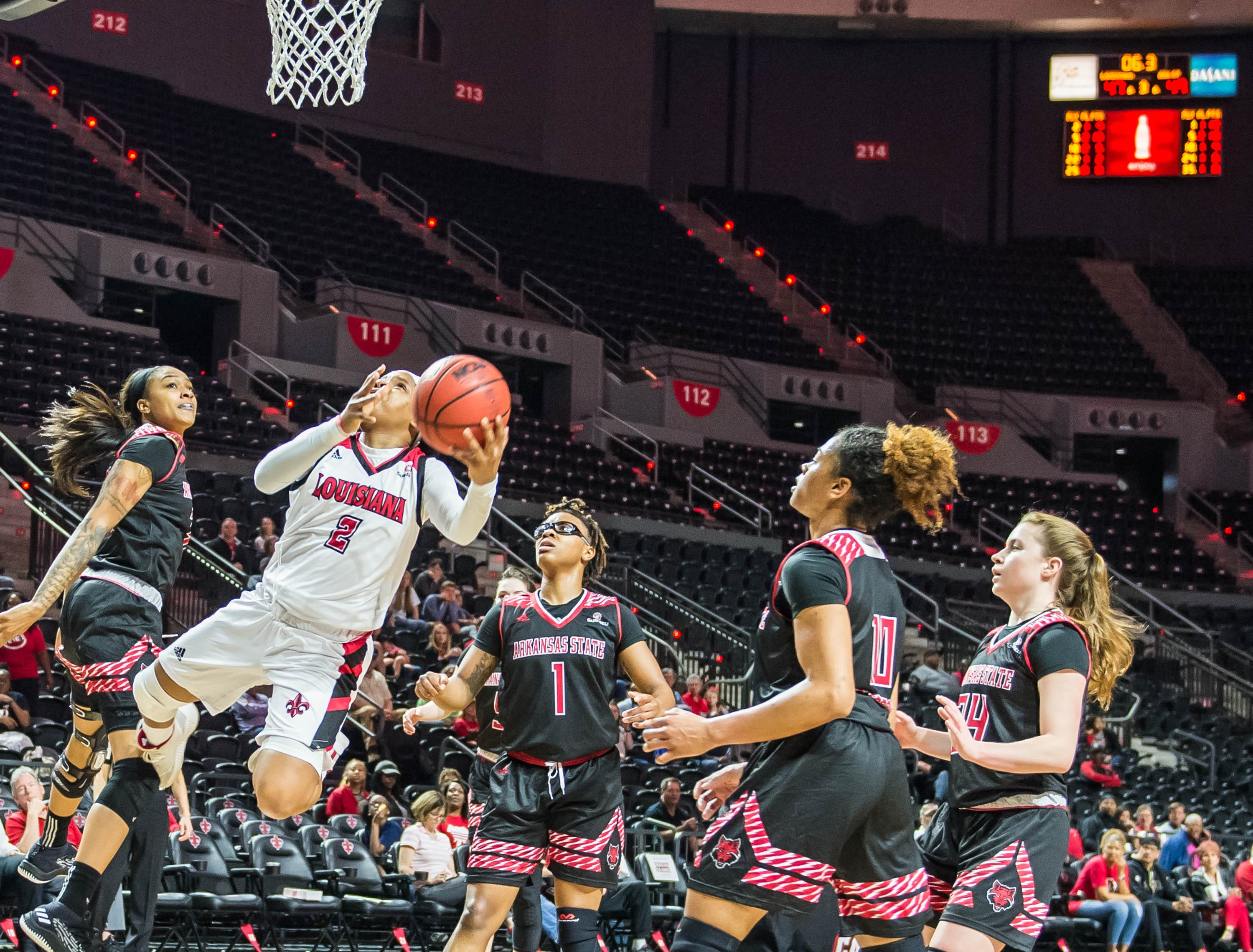 Cajuns Brandi Williams (2) with the layup and draws the foul for the 3-point play as the Cajuns women's basketball team plays the Arkansas State Red Wolves at the Cajundome on Saturday, March 9, 2019.