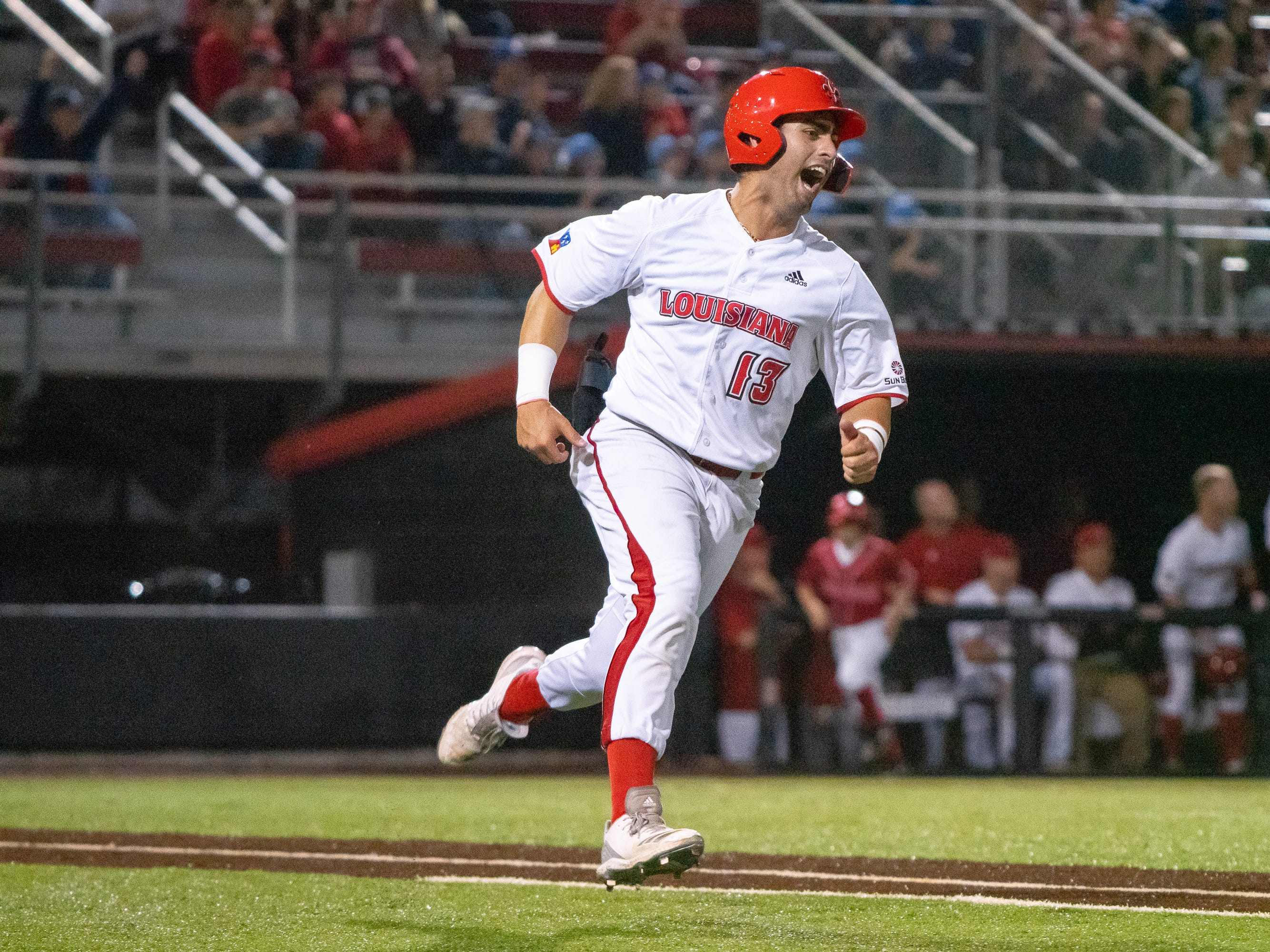 "UL's Sebastian Toro celebrates while running to first base as the Ragin' Cajuns take on the Loyola Marymount Lions at M.L. ""Tigue"" Moore Field on Friday, March 8, 2019."