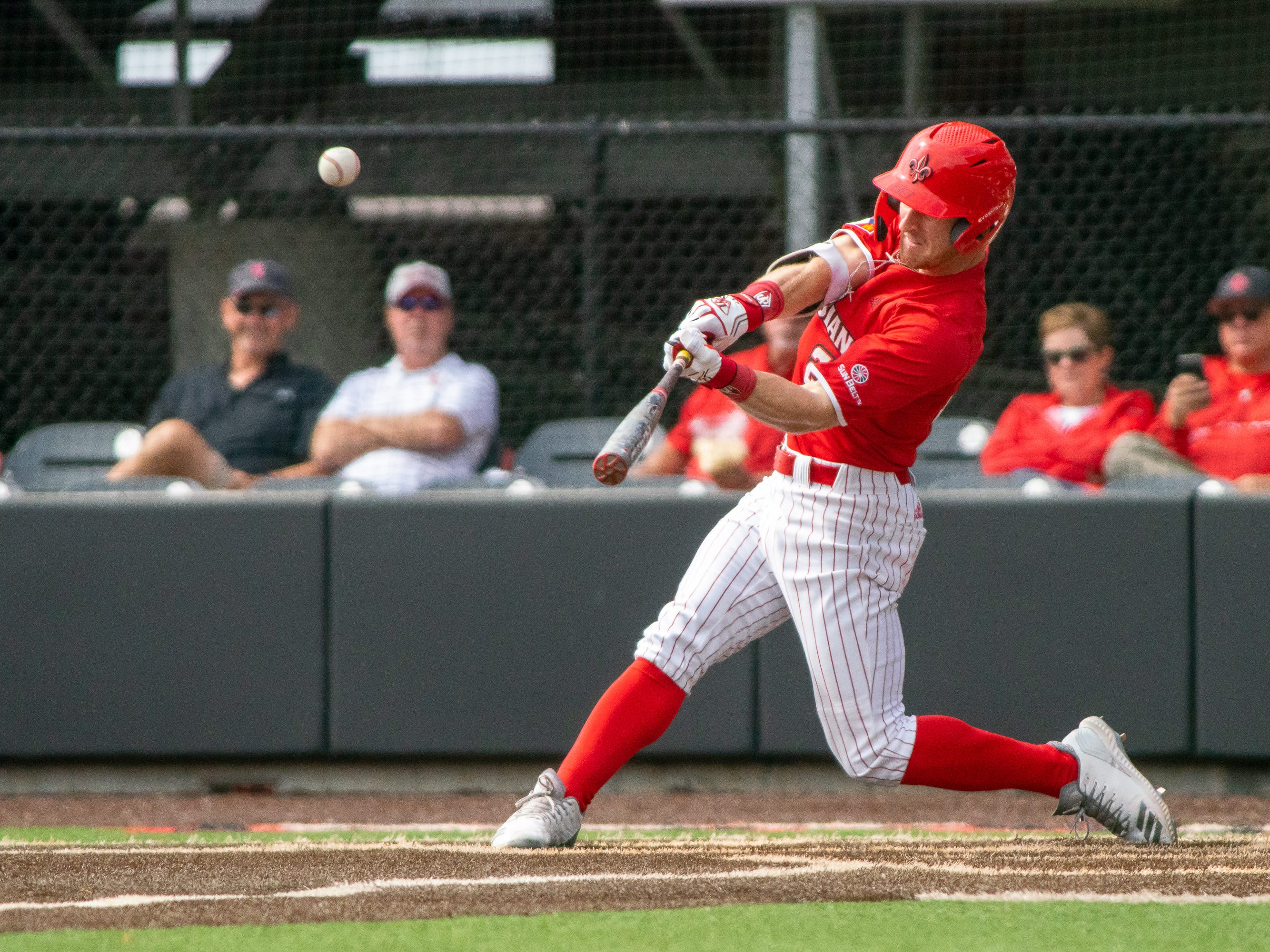 UL's Daniel Lahare hits the incoming ball as the Ragin' Cajuns take on the Loyola-Marymount Lions at M.L. Tigue Moore Field on Saturday, March 9, 2019.