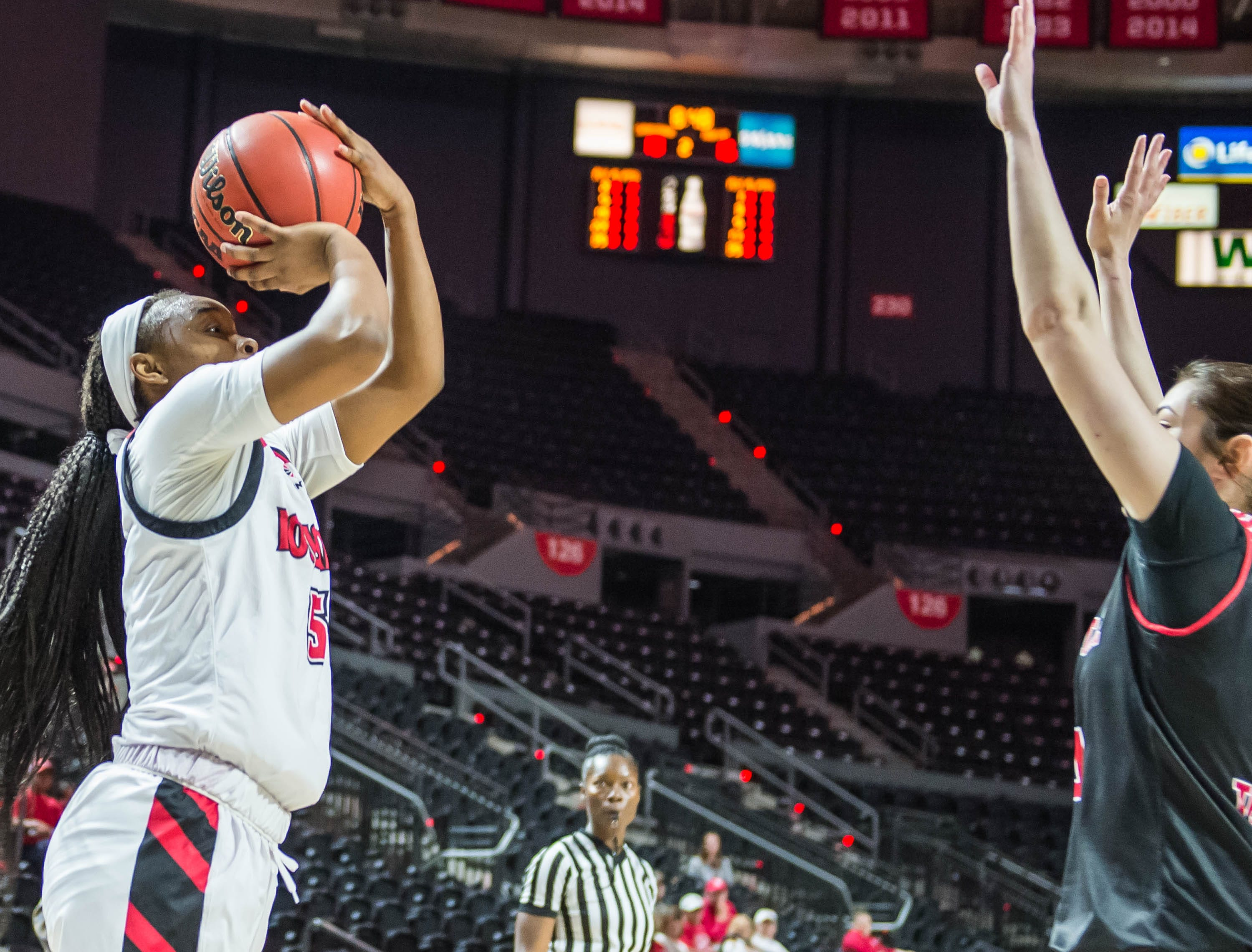 Cajuns guard Jomyra Mathis (5) with the jump shot as the Cajuns women's basketball team plays the Arkansas State Red Wolves at the Cajundome on Saturday, March 9, 2019.