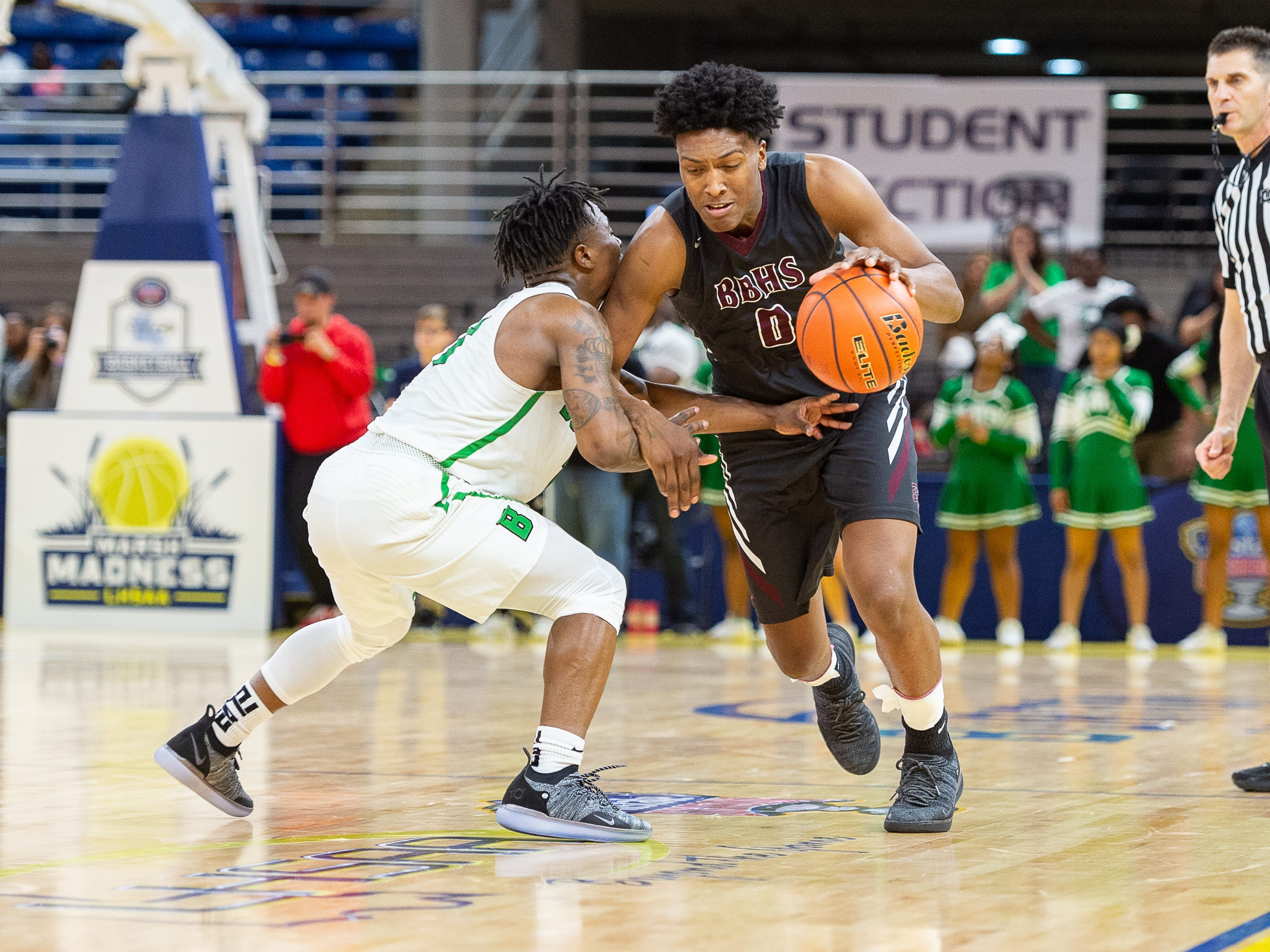 Deandre Hypolite drives the ball as Breaux Bridge beats Bossier 61-58 to win the Allstate Sugar Bowl/LHSAA Boys' Marsh Madness State Championship. Friday, March 8, 2019.