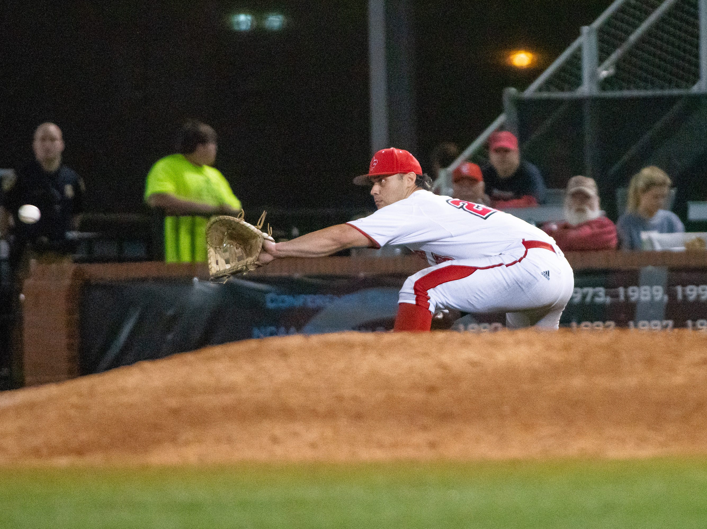 "UL's Handsome Monica catches the throw to first to get the runner out as the Ragin' Cajuns take on the Loyola Marymount Lions at M.L. ""Tigue"" Moore Field on Friday, March 8, 2019."