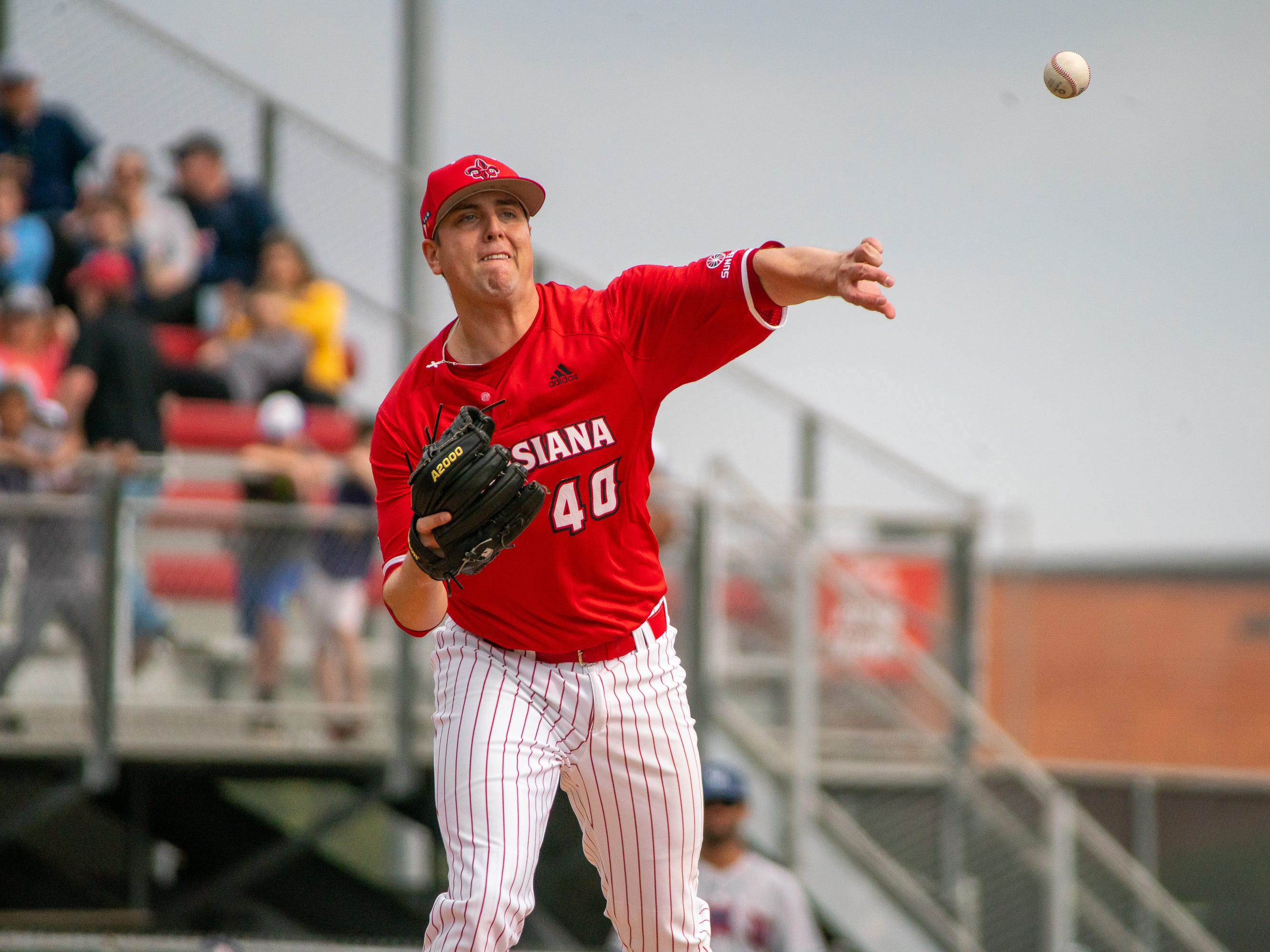 UL's pitcher Dalton Horton throws to first base as the Ragin' Cajuns take on the Loyola-Marymount Lions at M.L. Tigue Moore Field on Saturday, March 9, 2019.