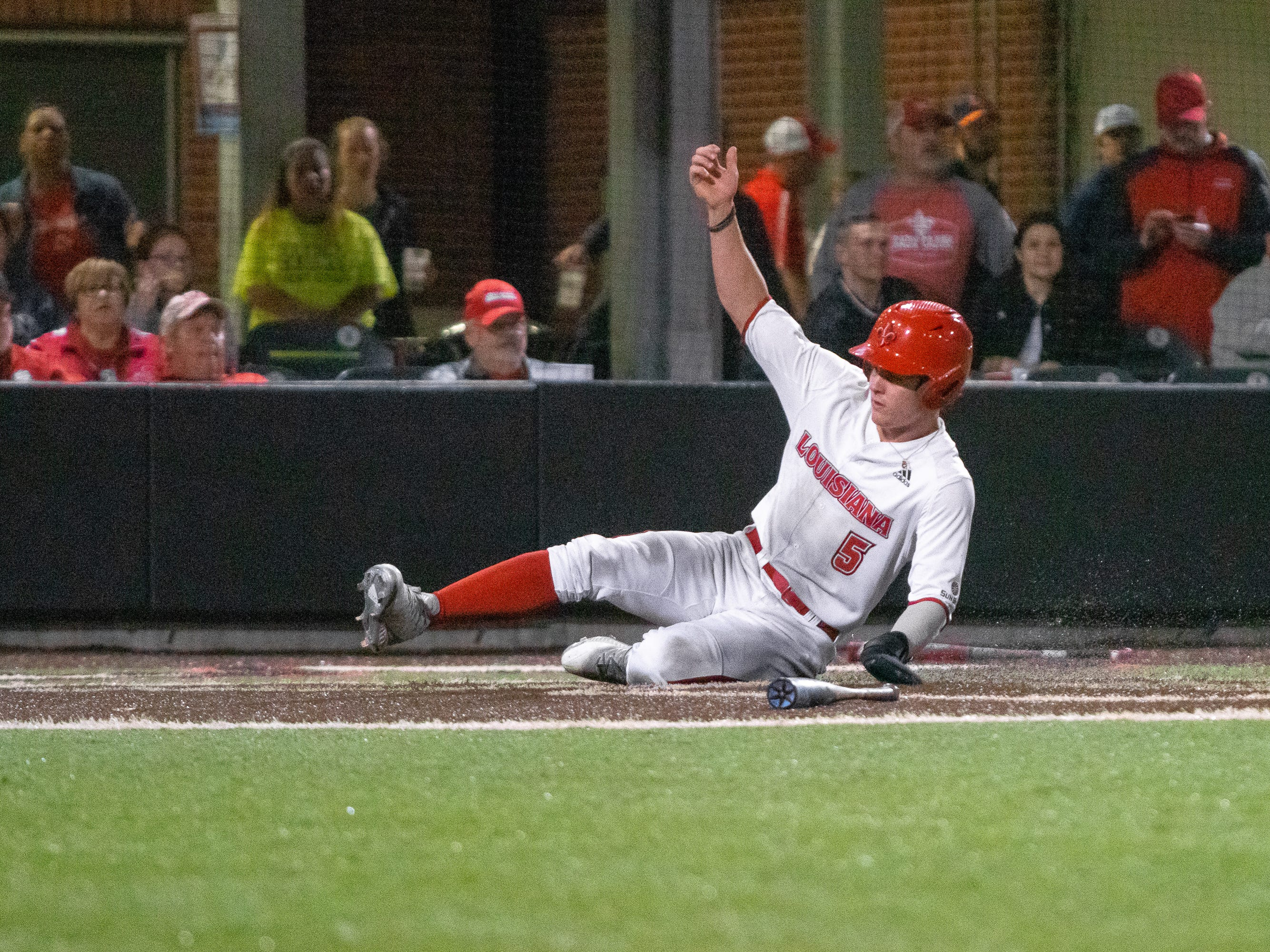 "UL's Hayden Cantrelle slides onto home plate to score a run as the Ragin' Cajuns take on the Loyola Marymount Lions at M.L. ""Tigue"" Moore Field on Friday, March 8, 2019."