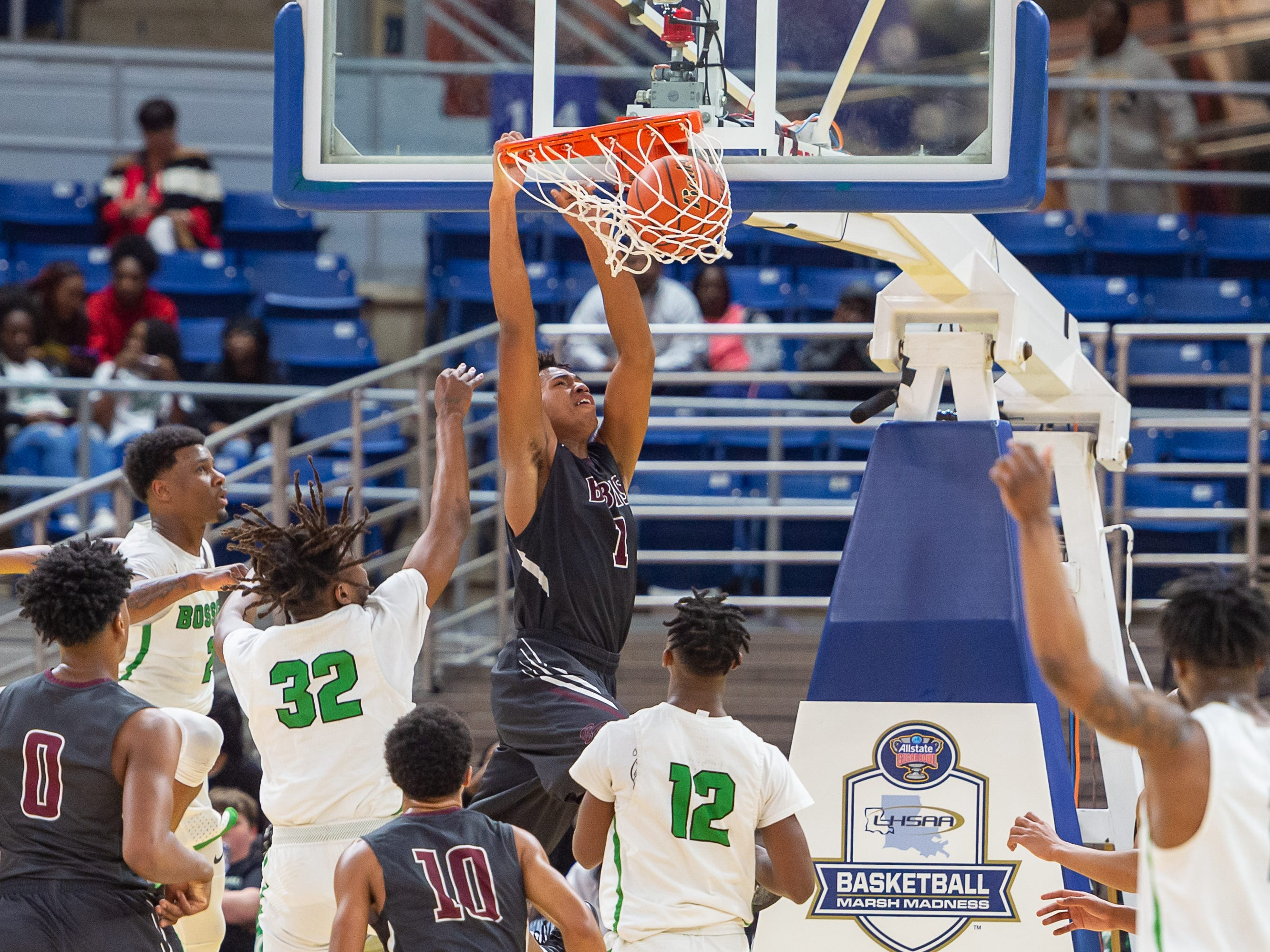 Trevonte Sylvester dunks the ball as Breaux Bridge takes on Bossier in the Allstate Sugar Bowl/LHSAA Boys' Marsh Madness State Championship. Friday, March 8, 2019.