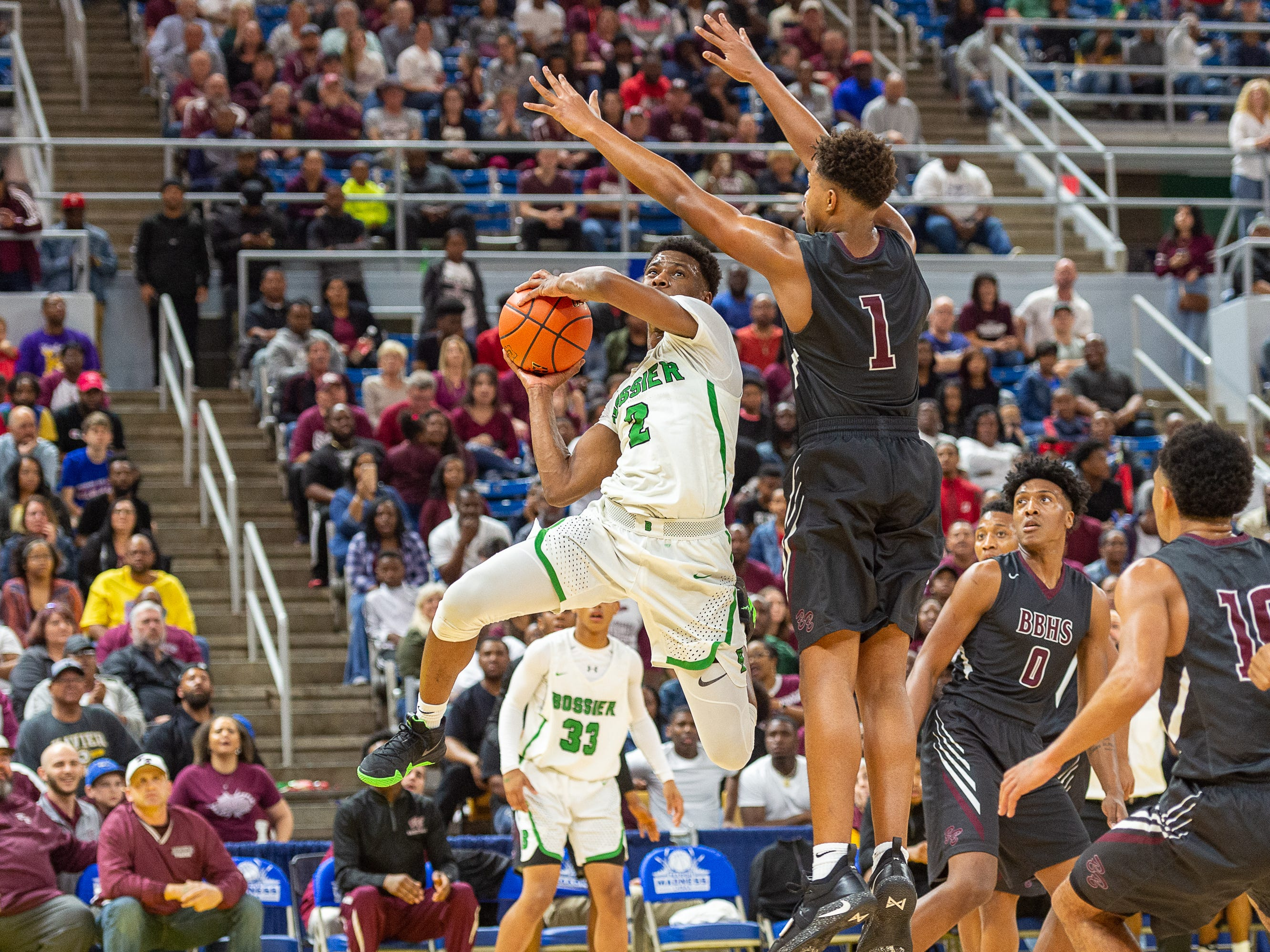 Xavien Beasley takes a shot as Breaux Bridge takes on Bossier in the Allstate Sugar Bowl/LHSAA Boys' Marsh Madness State Championship. Friday, March 8, 2019.