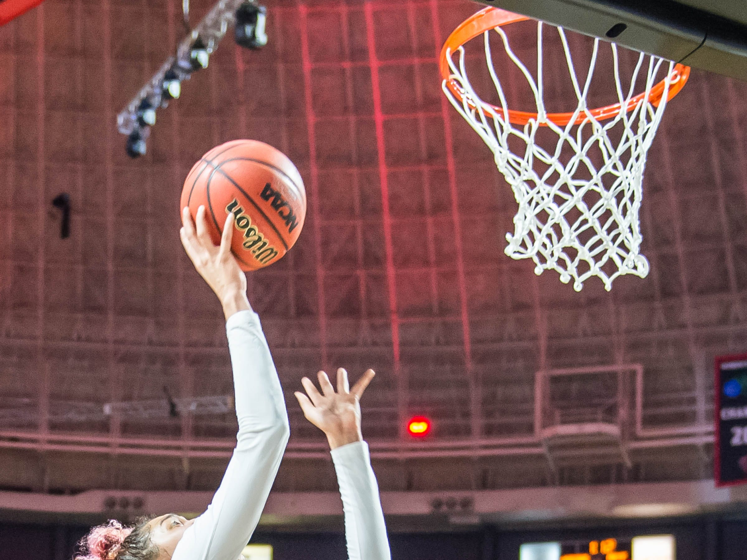Cajuns forward Kendall Bess (22) with the shot on the inside as the Cajuns women's basketball team plays the Arkansas State Red Wolves at the Cajundome on Saturday, March 9, 2019.