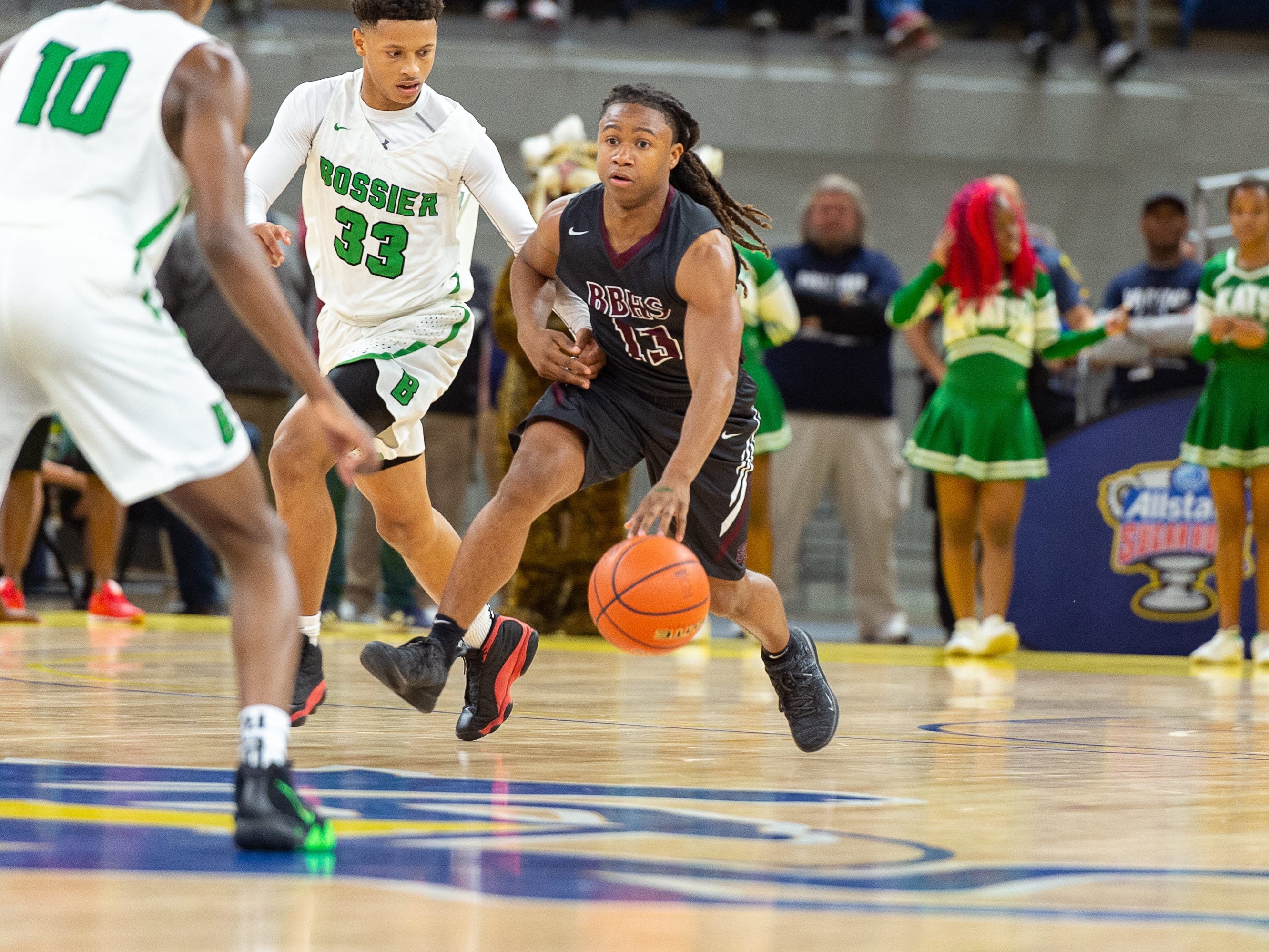 Kavion Martin drives the ball as Breaux Bridge beats Bossier 61-58 to win the Allstate Sugar Bowl/LHSAA Boys' Marsh Madness State Championship. Friday, March 8, 2019.