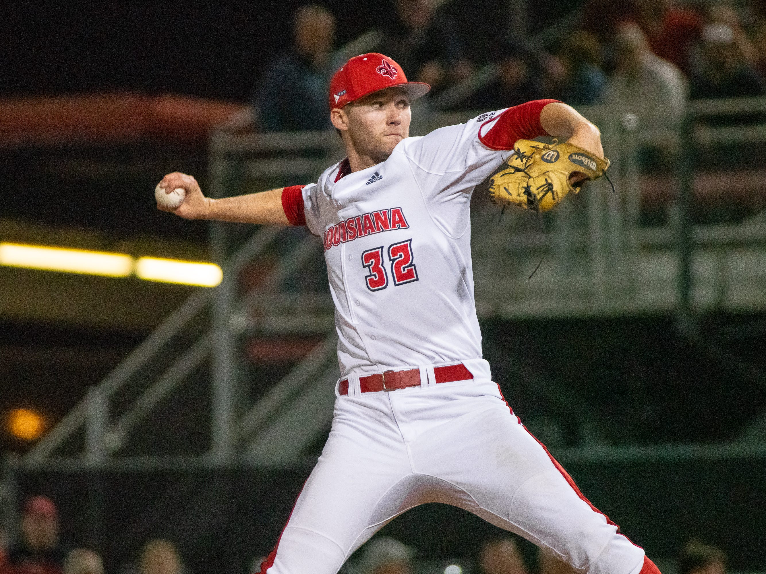 "UL's Brandon Young throws to the batter as the Ragin' Cajuns take on the Loyola Marymount Lions at M.L. ""Tigue"" Moore Field on Friday, March 8, 2019."