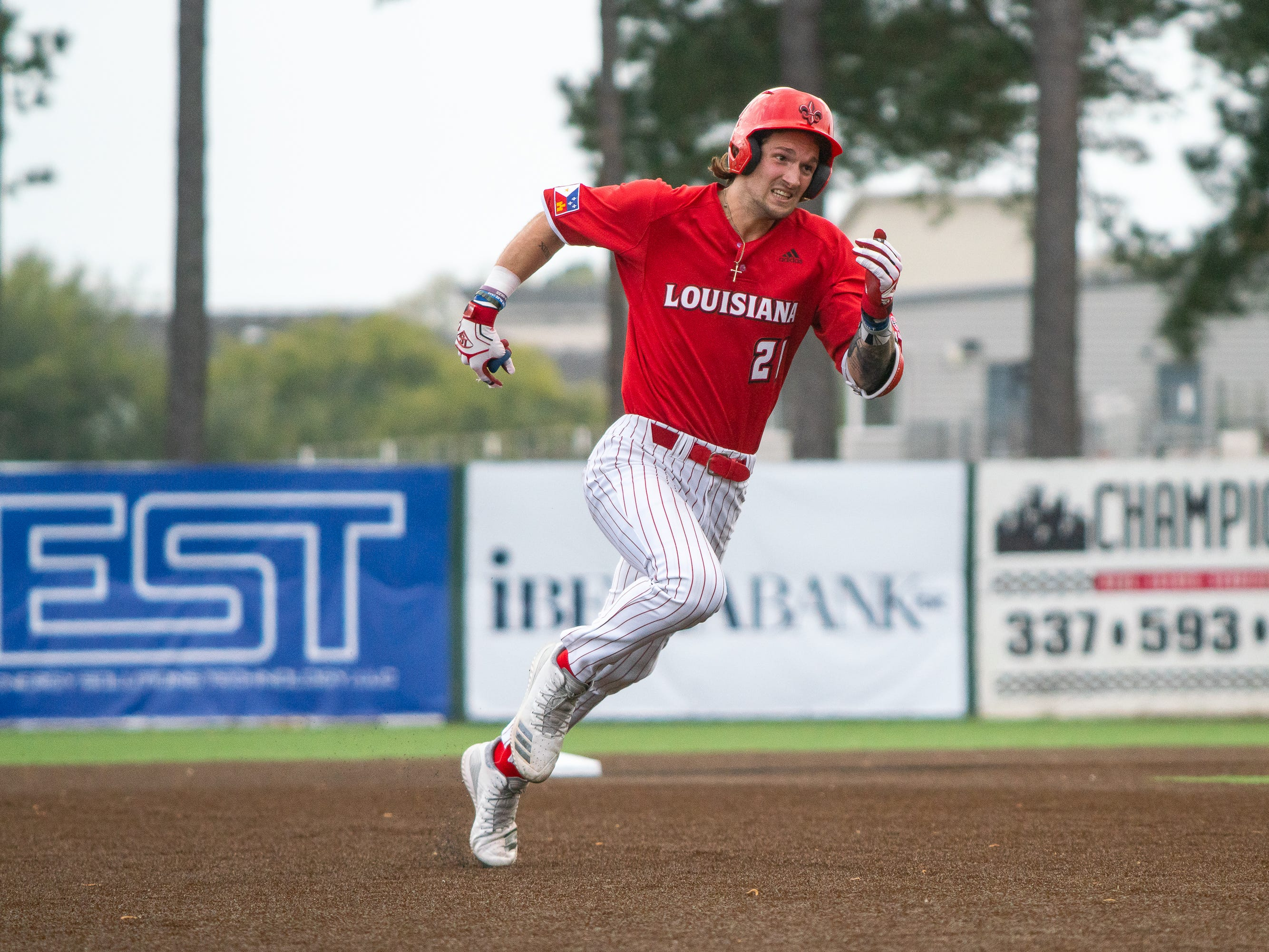 UL's Orynn Veillon sprints to third base as the Ragin' Cajuns take on the Loyola-Marymount Lions at M.L. Tigue Moore Field on Saturday, March 9, 2019.