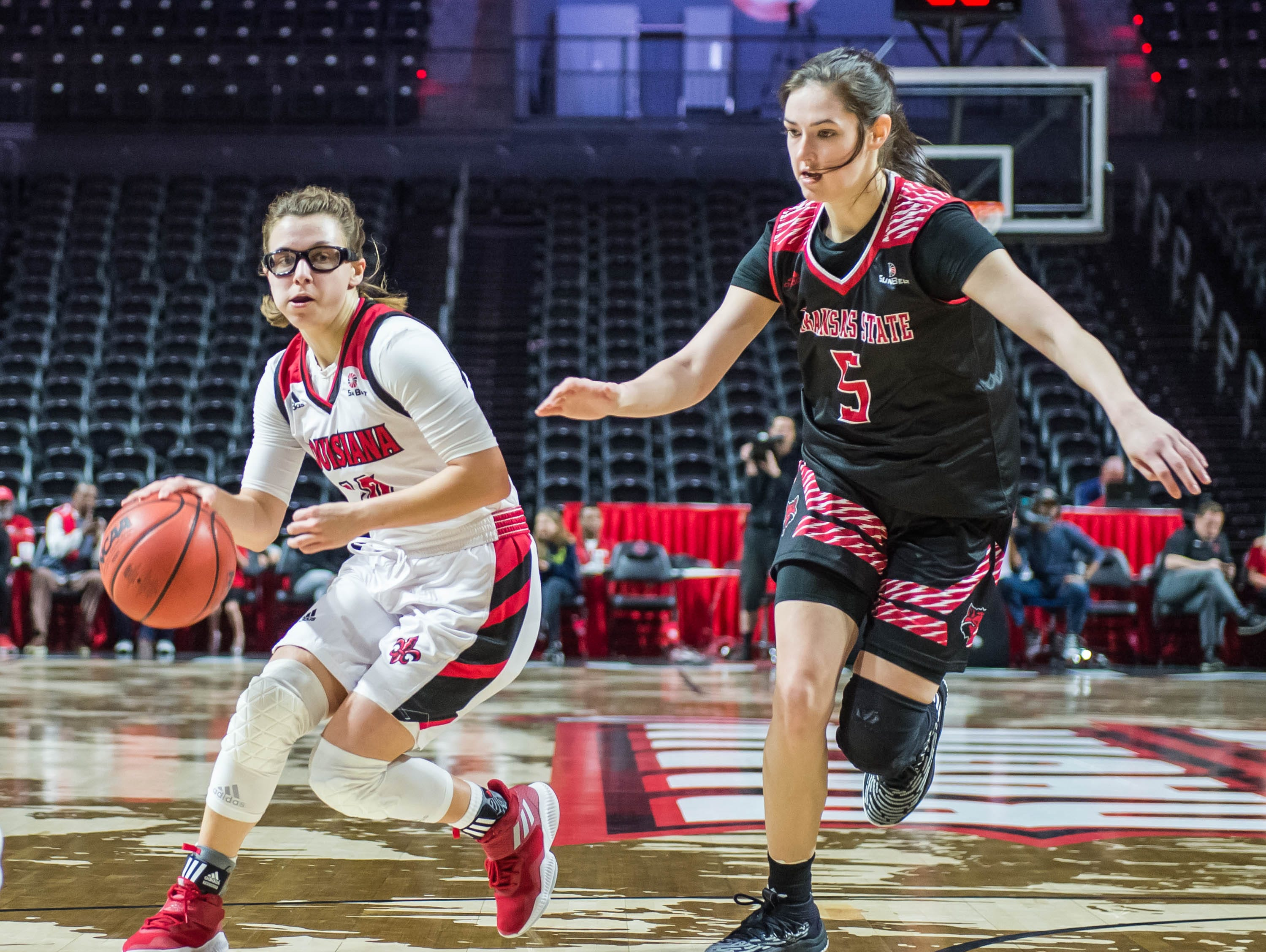 Cajuns Andrea Cournoyer (10) drives the ball pass Red Wolves Payton Tennison (5) as the Cajuns women's basketball team plays the Arkansas State Red Wolves at the Cajundome on Saturday, March 9, 2019.