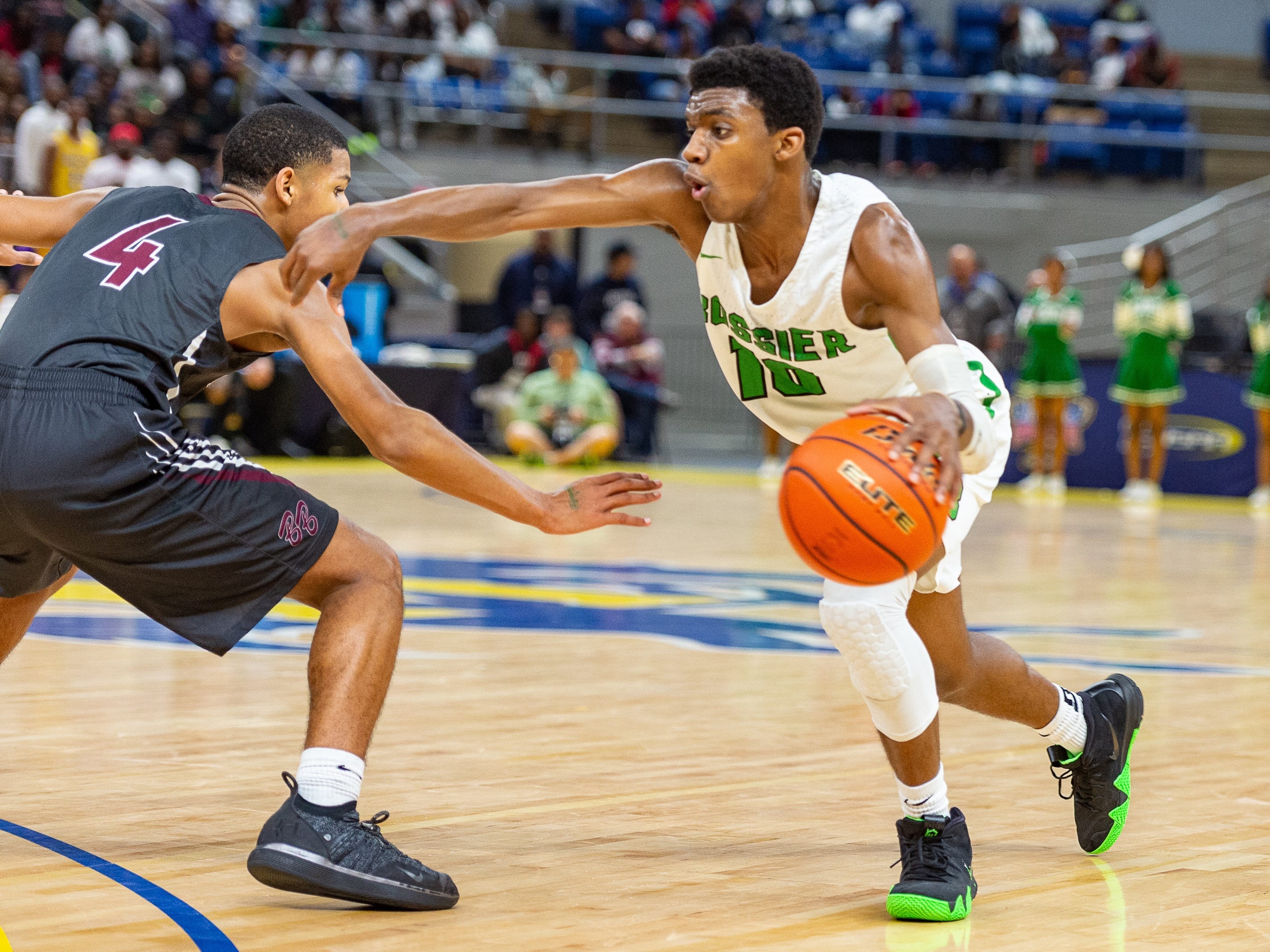 Kaalas Roots drives to the basket as Breaux Bridge takes on Bossier in the Allstate Sugar Bowl/LHSAA Boys' Marsh Madness State Championship. Friday, March 8, 2019.