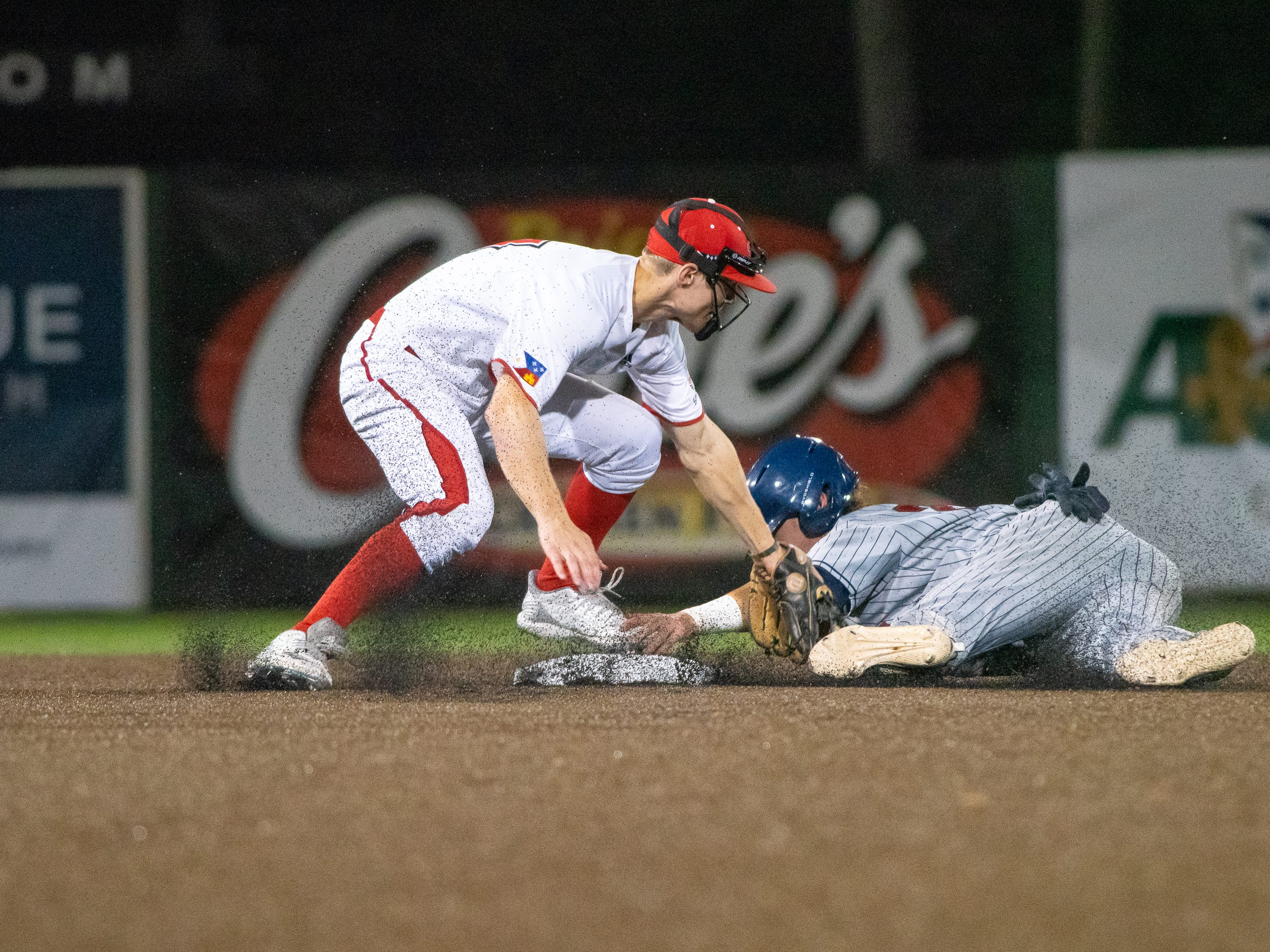 "UL's Hunter Kasuls tags the runner at second base as the Ragin' Cajuns take on the Loyola Marymount Lions at M.L. ""Tigue"" Moore Field on Friday, March 8, 2019."