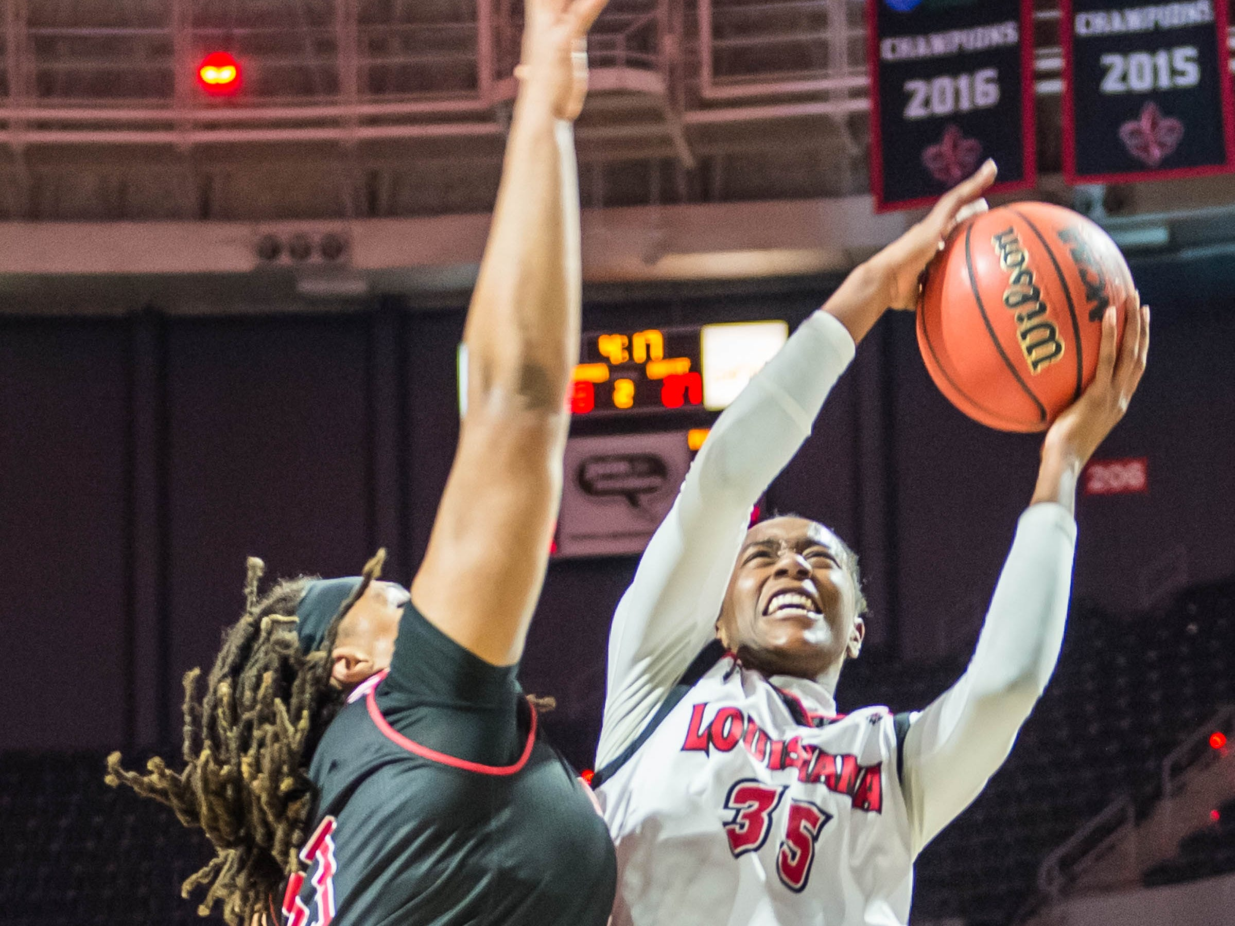 Cajuns center Ty'Reona Doucet (35) takes the ball to the basket for 2 as the Cajuns women's basketball team plays the Arkansas State Red Wolves at the Cajundome on Saturday, March 9, 2019.