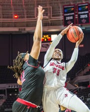 Cajuns center Ty'Reona Doucet (35) takes the ball to the basket for 2 on Saturday against Arkansas at the Cajundome.