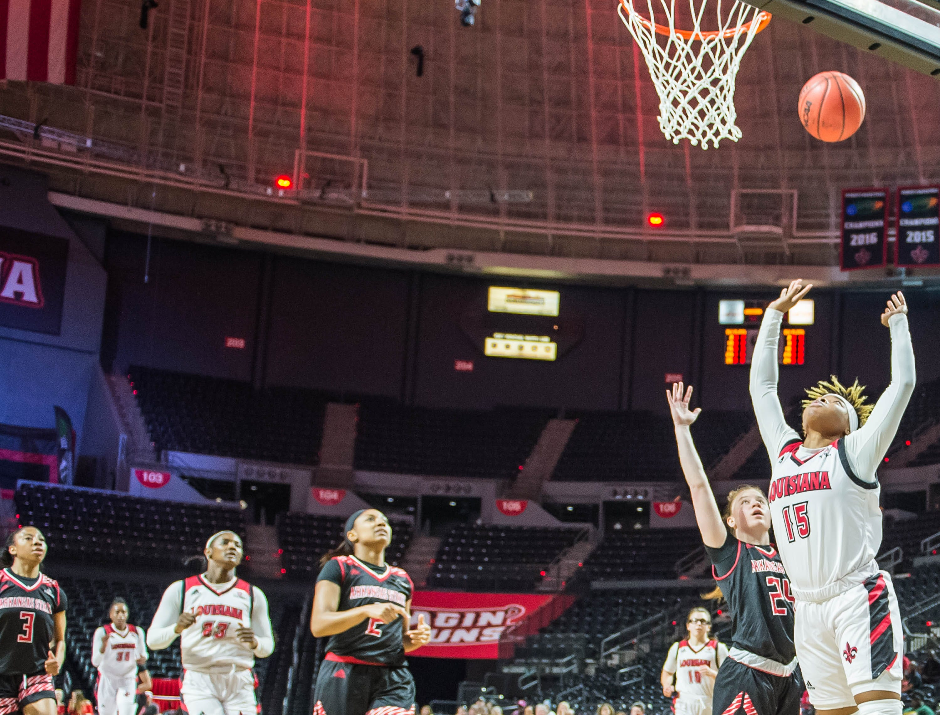 Cajuns guard Diamond Morrison (15) with the layup as the Cajuns women's basketball team plays the Arkansas State Red Wolves at the Cajundome on Saturday, March 9, 2019.