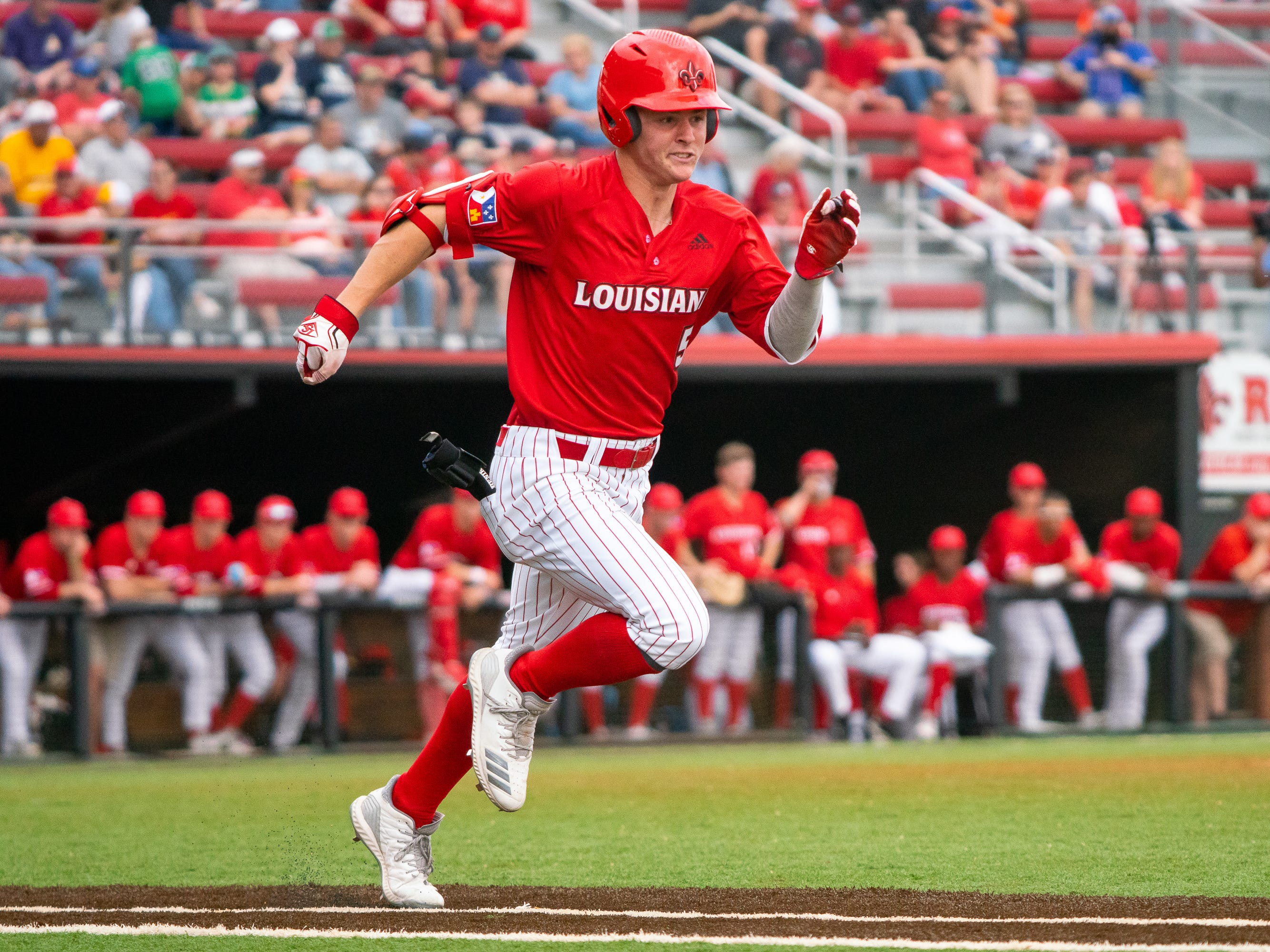UL's Hayden Cantrelle sprints to first base as the Ragin' Cajuns take on the Loyola-Marymount Lions at M.L. Tigue Moore Field on Saturday, March 9, 2019.