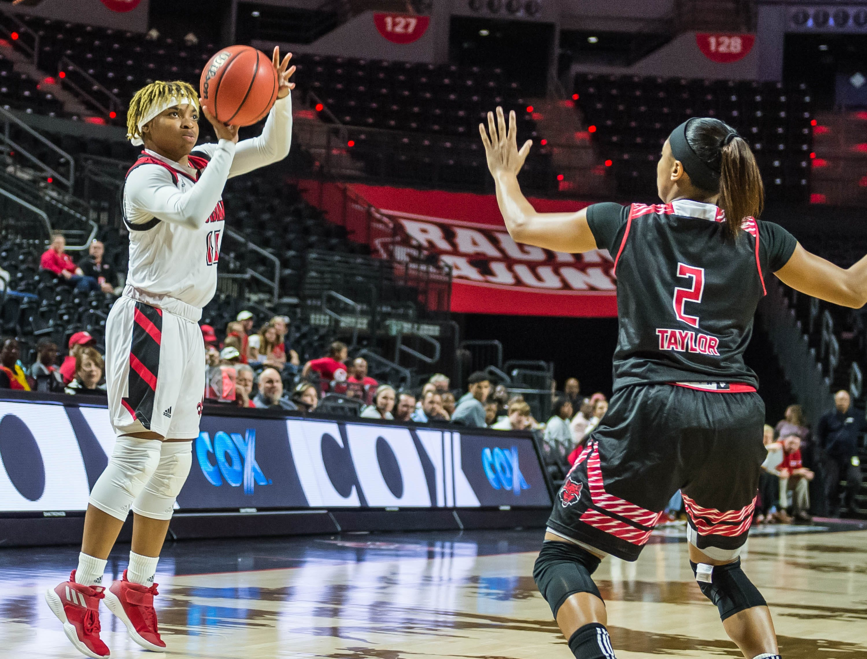 Cajuns guard Diamond Morrison (15) with the 3-point attempt as the Cajuns women's basketball team plays the Arkansas State Red Wolves at the Cajundome on Saturday, March 9, 2019.