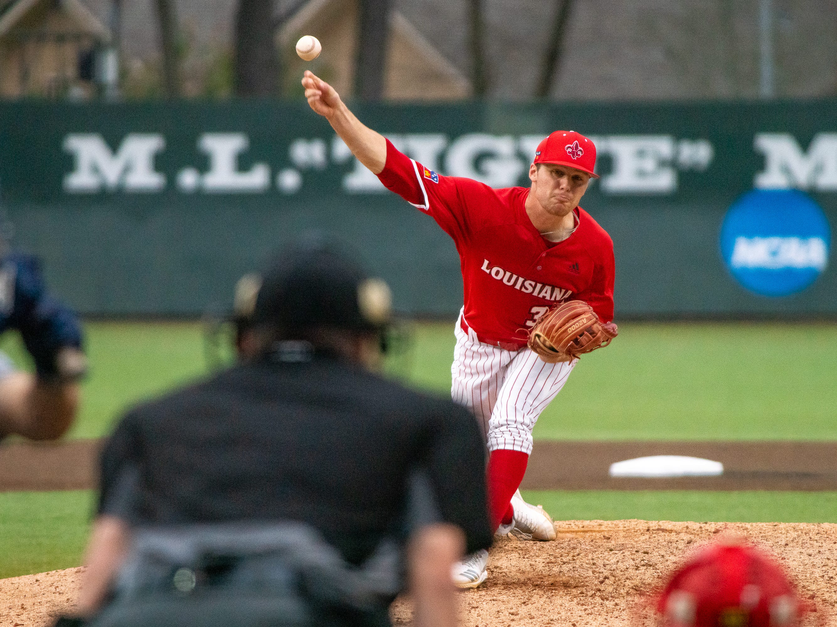 UL's Michael Leaumont throws the pitch to the batter as the Ragin' Cajuns take on the Loyola-Marymount Lions at M.L. Tigue Moore Field on Saturday, March 9, 2019.