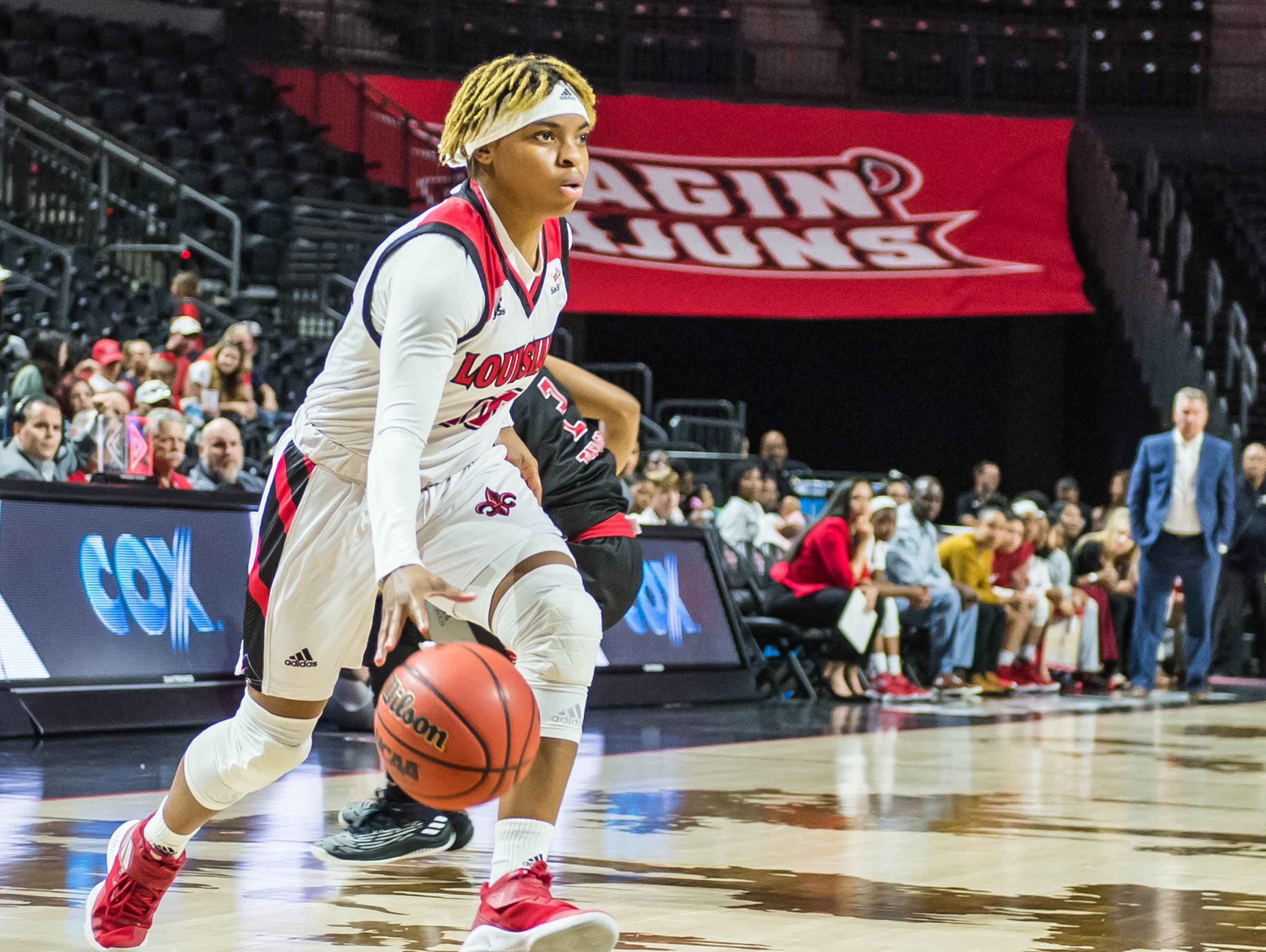 Ragin' Cajuns guard Diamond Morrison (15) works the ball to the basket as the Cajuns women's basketball team plays the Arkansas State Red Wolves at the Cajundome on Saturday, March 9, 2019.