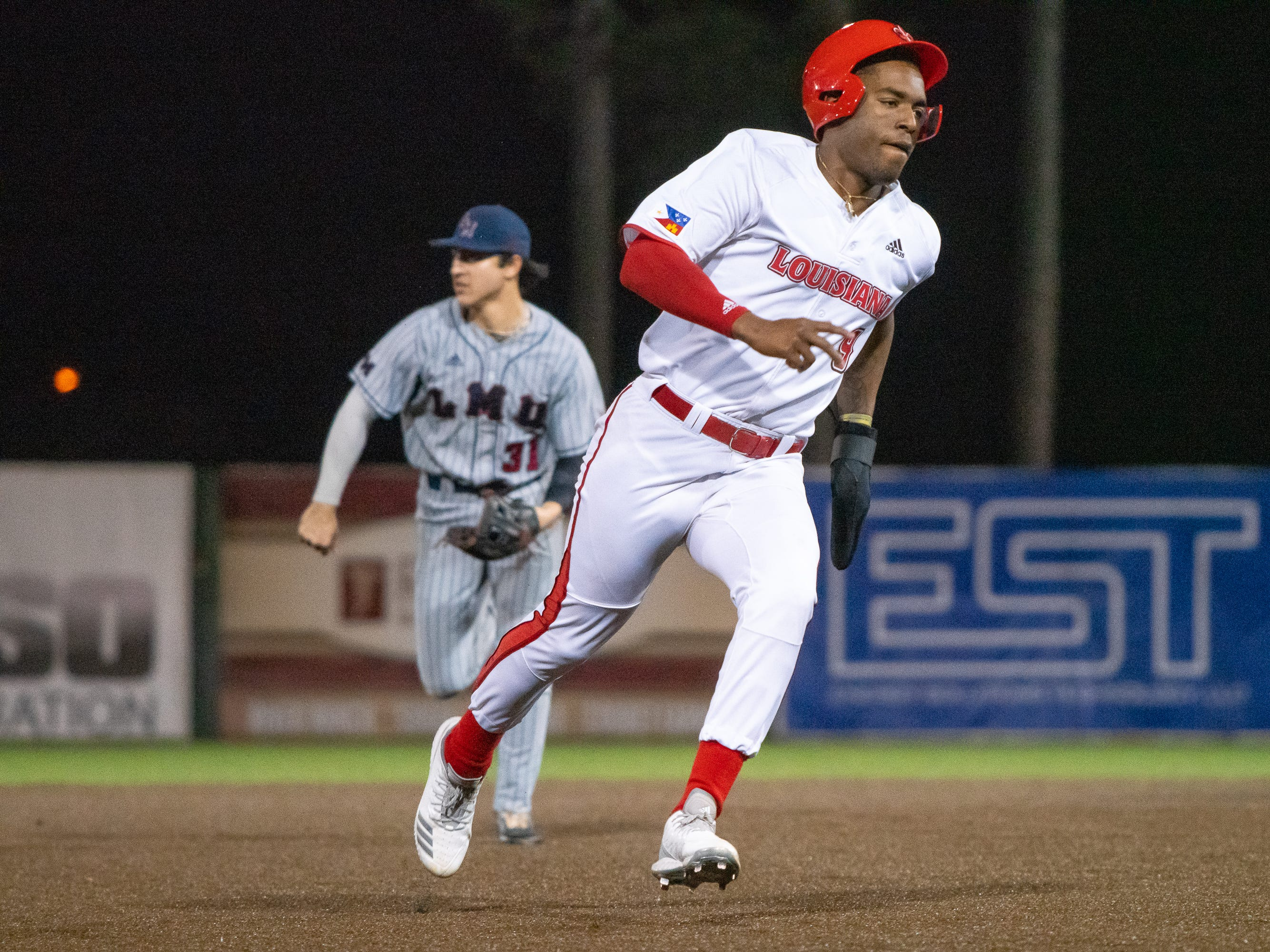 "UL's Todd Lott rounds third base and heads for home plate as the Ragin' Cajuns take on the Loyola Marymount Lions at M.L. ""Tigue"" Moore Field on Friday, March 8, 2019."