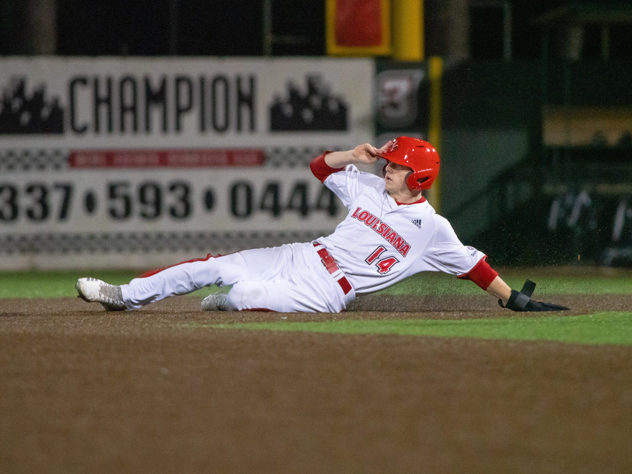 "UL's Nathan Camp slides to steal second base as the Ragin' Cajuns take on the Loyola Marymount Lions at M.L. ""Tigue"" Moore Field on Friday, March 8, 2019."