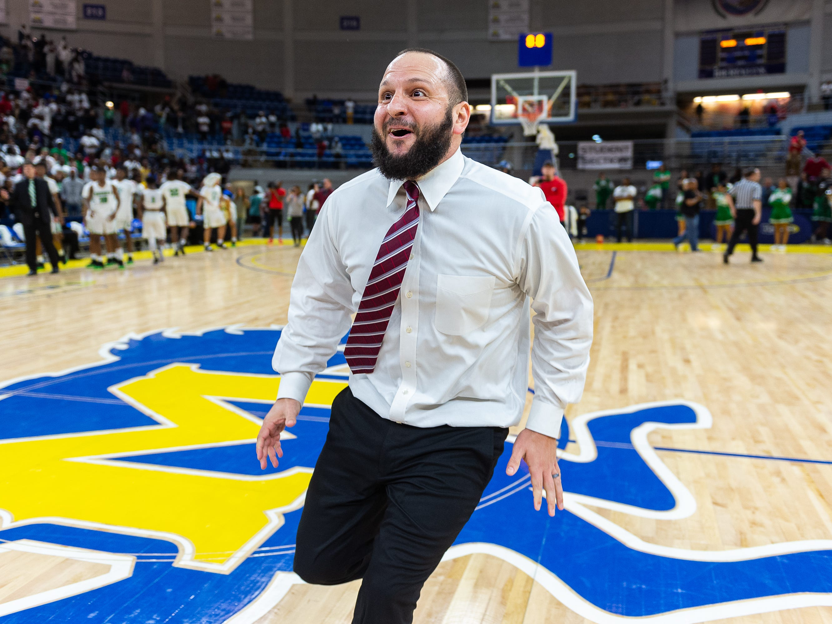 Head Coach Chad Pourciau II celebrates as Breaux Bridge beats Bossier 61-58 to win the Allstate Sugar Bowl/LHSAA Boys' Marsh Madness State Championship. Friday, March 8, 2019.