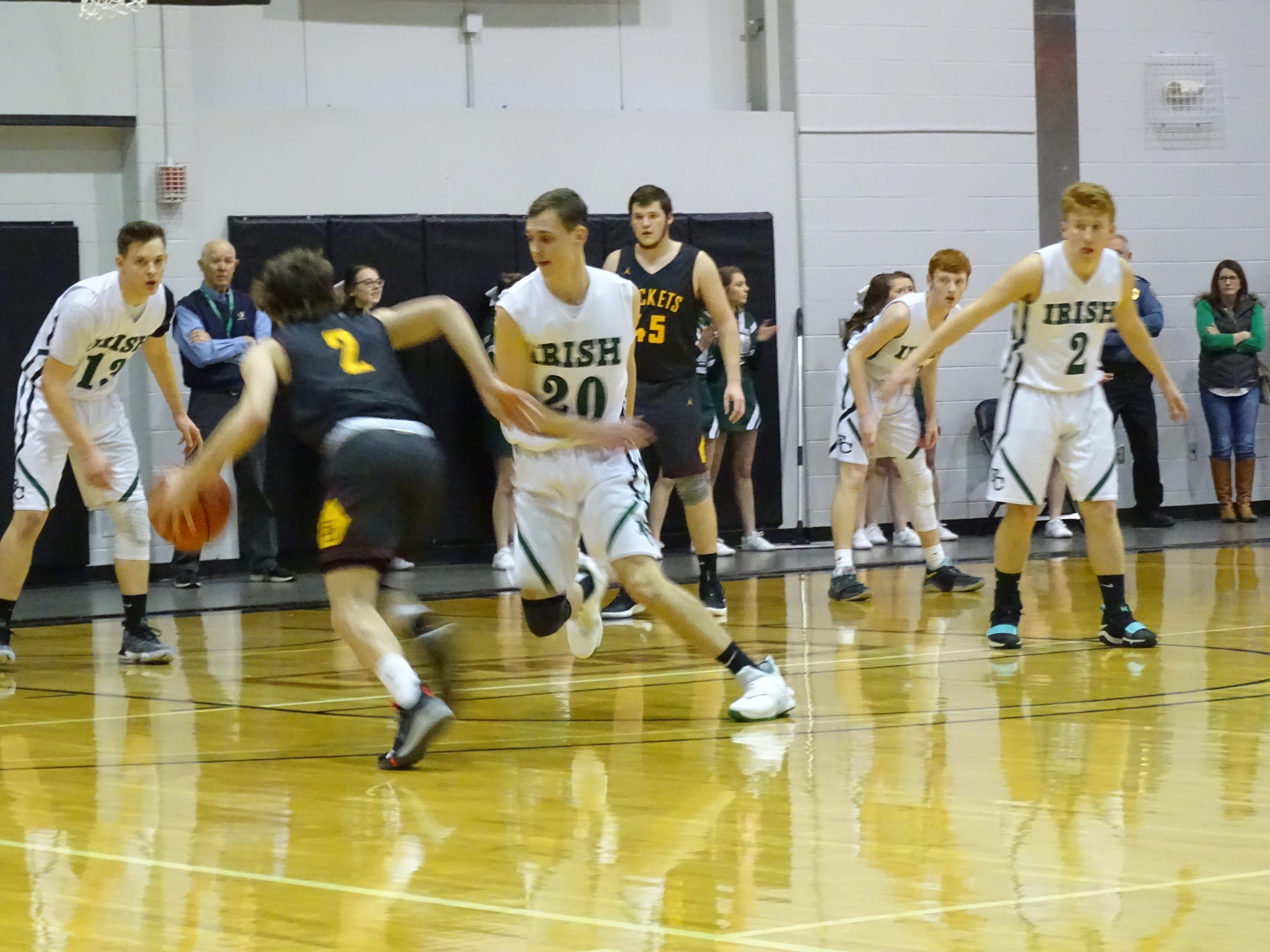 Chase McCartney drives past Fisher Catholic's Bryson Vogel during the Rockets' 50-40 Division IV district final win Saturday.