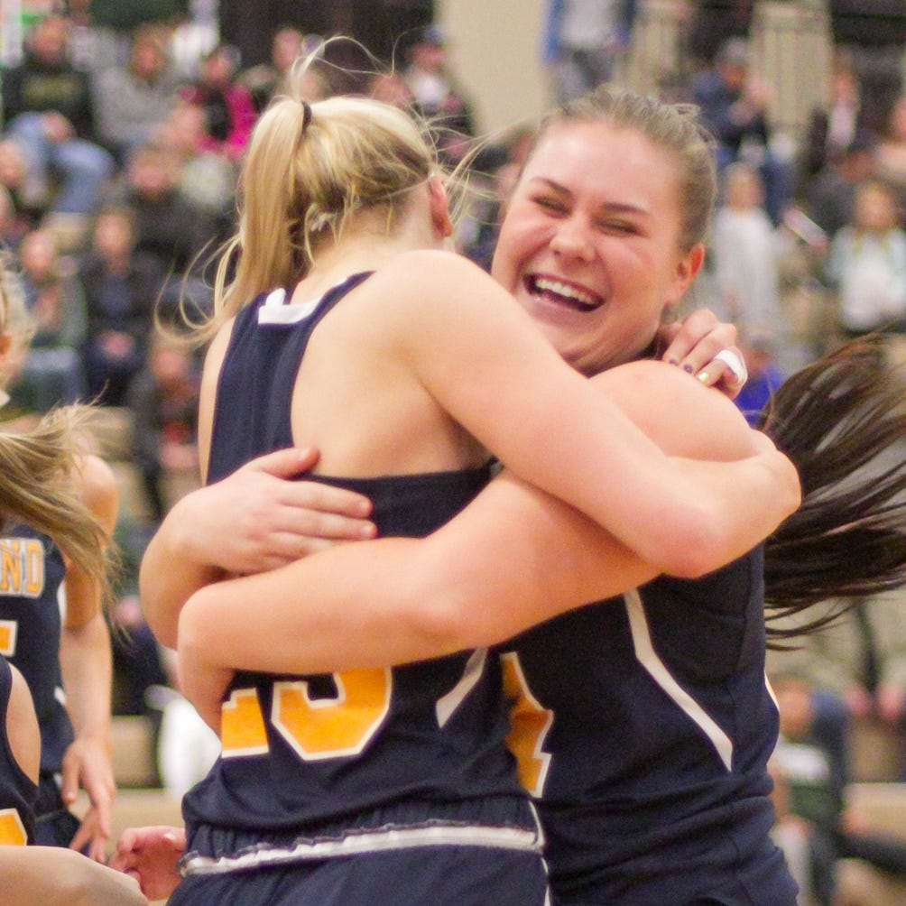 Only senior on Hartland's district championship basketball team embraces limited role