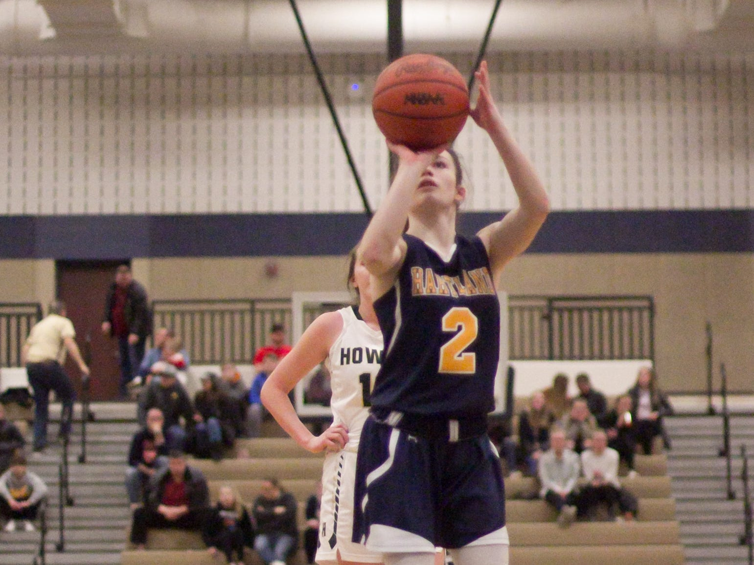 Hartland's Syd Caddell shoots a free throw in the fourth period of the district championship game against Howell Friday, March 8, 2019.