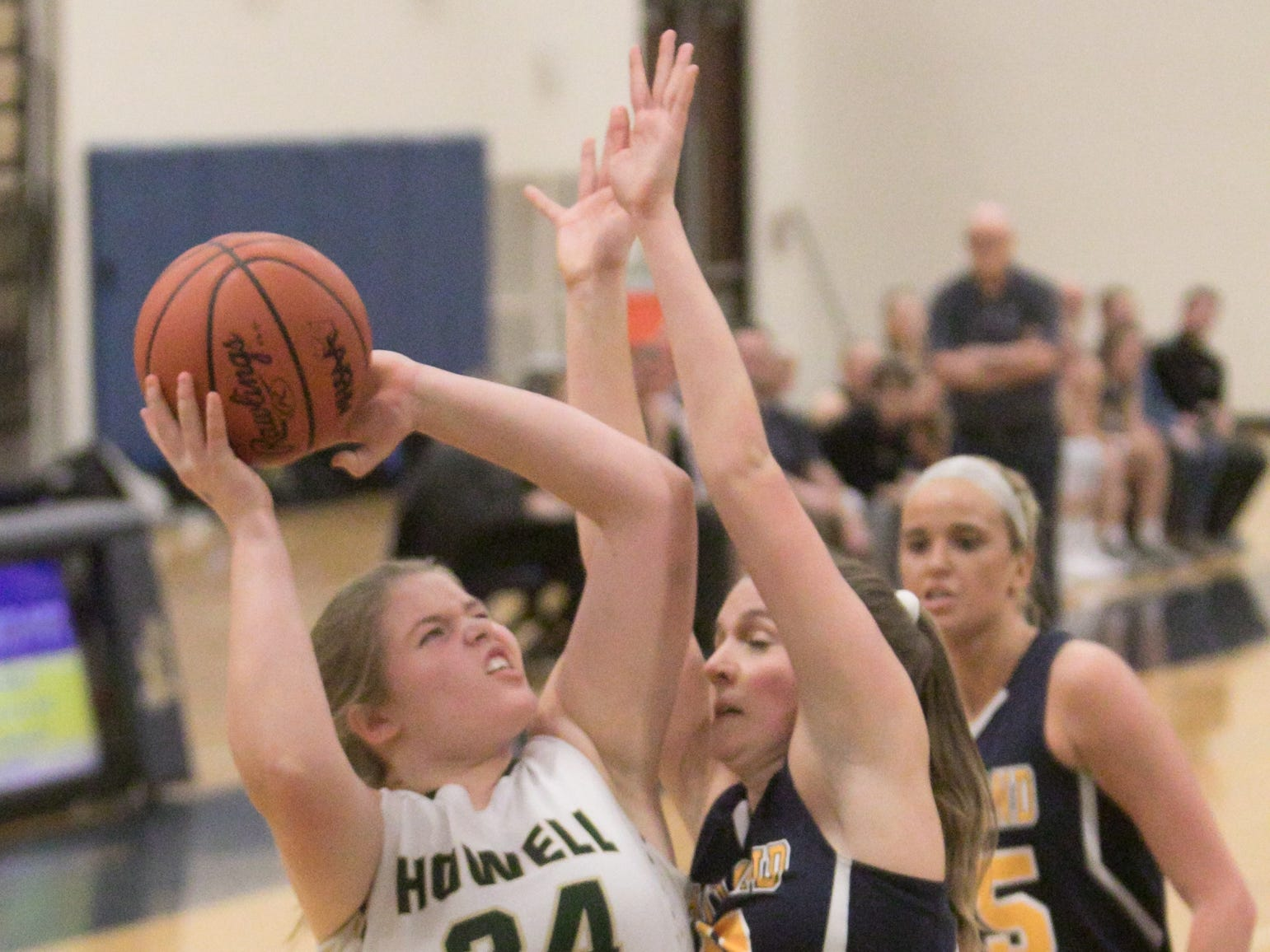 Howell's Bryta Mathes shoots in the fourth quarter against Hartland Friday, March 8, 2019.