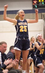 Hartland's Whitney Sollom (25), Nikki Dompierre (10) and the Eagles celebrate a 42-28 victory over Howell in the district championship game on Friday, March 8, 2019.