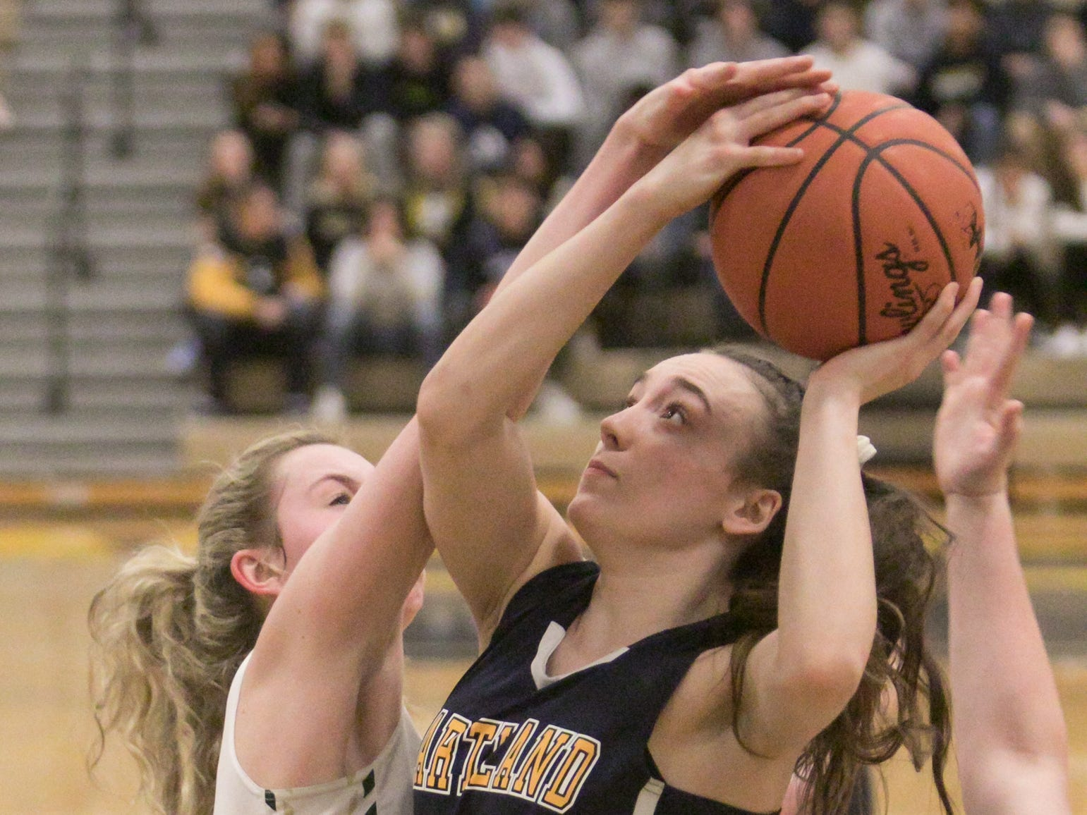 Madi Moyer of Hartland is fouled in the second period of the home championship game against Howell Friday, March 8, 2019.