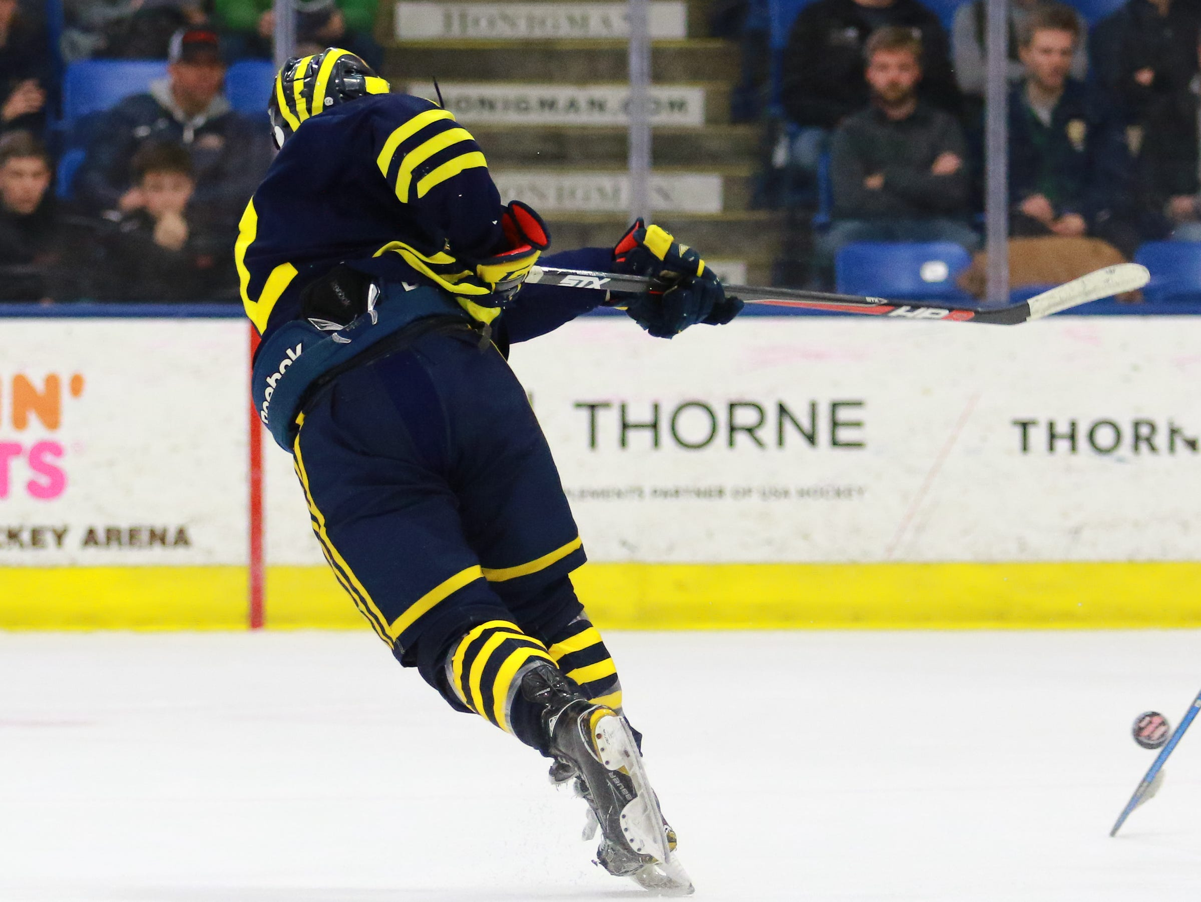 Hartland's Kieran Carlile lets a shot fly in a 4-0 victory over Trenton in the state Division 2 championship hockey game on Saturday, March 9, 2019 at USA Hockey Arena.