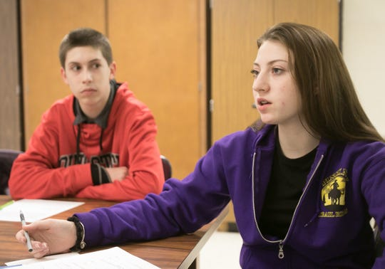 Pinckney Community High School freshman Katie Wheaton, 15, talks about vaping at Pathfinder School Thursday, March 7, 2019 as fellow freshman Benjamin Welch, 15, listens.