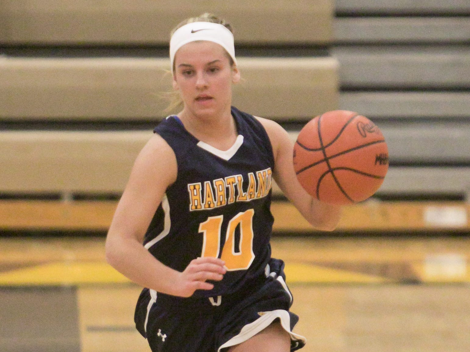 Hartland Eagle Nikki Dompierre brings the ball in play in the district championship game against Howell Friday, March 8, 2019.