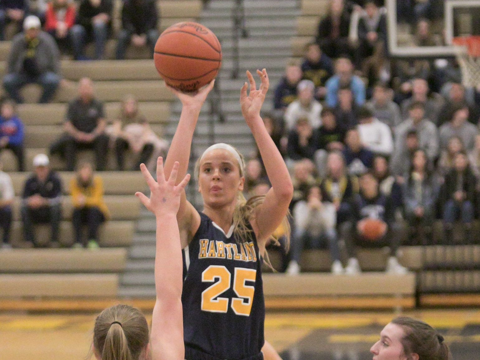 Whitney Sollom of Hartland makes this shot in the first period of district championship play against Howell Friday, March 8, 2019.