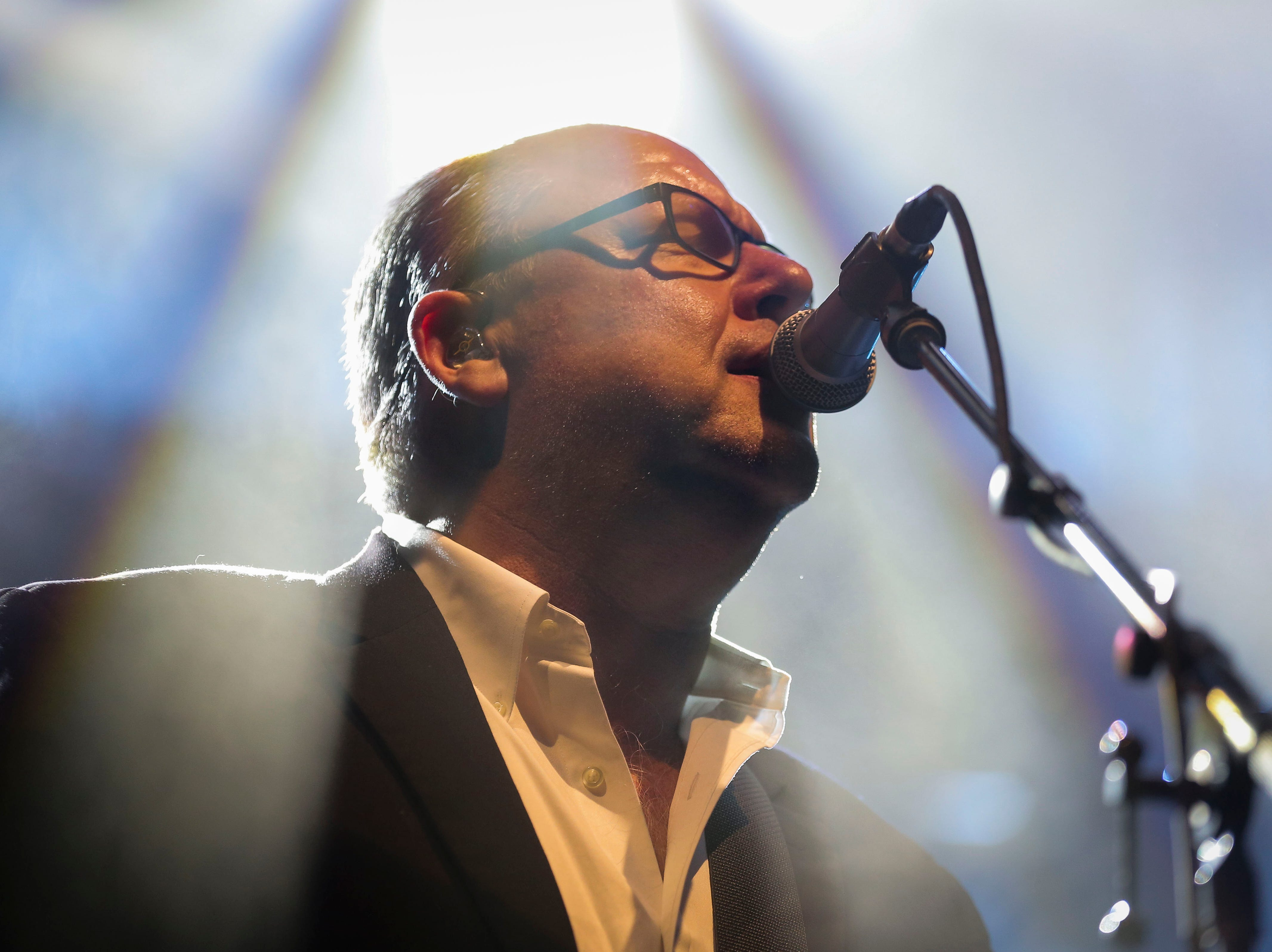 """Charles Thompson IV """"Black Francis,"""" lead vocalists and guitarist of The Pixies, performs during the first show of the  Weezer x Pixies 2019 tour at the KFC Yum! Center in downtown Louisville, Ky. on Friday, March 8, 2019."""