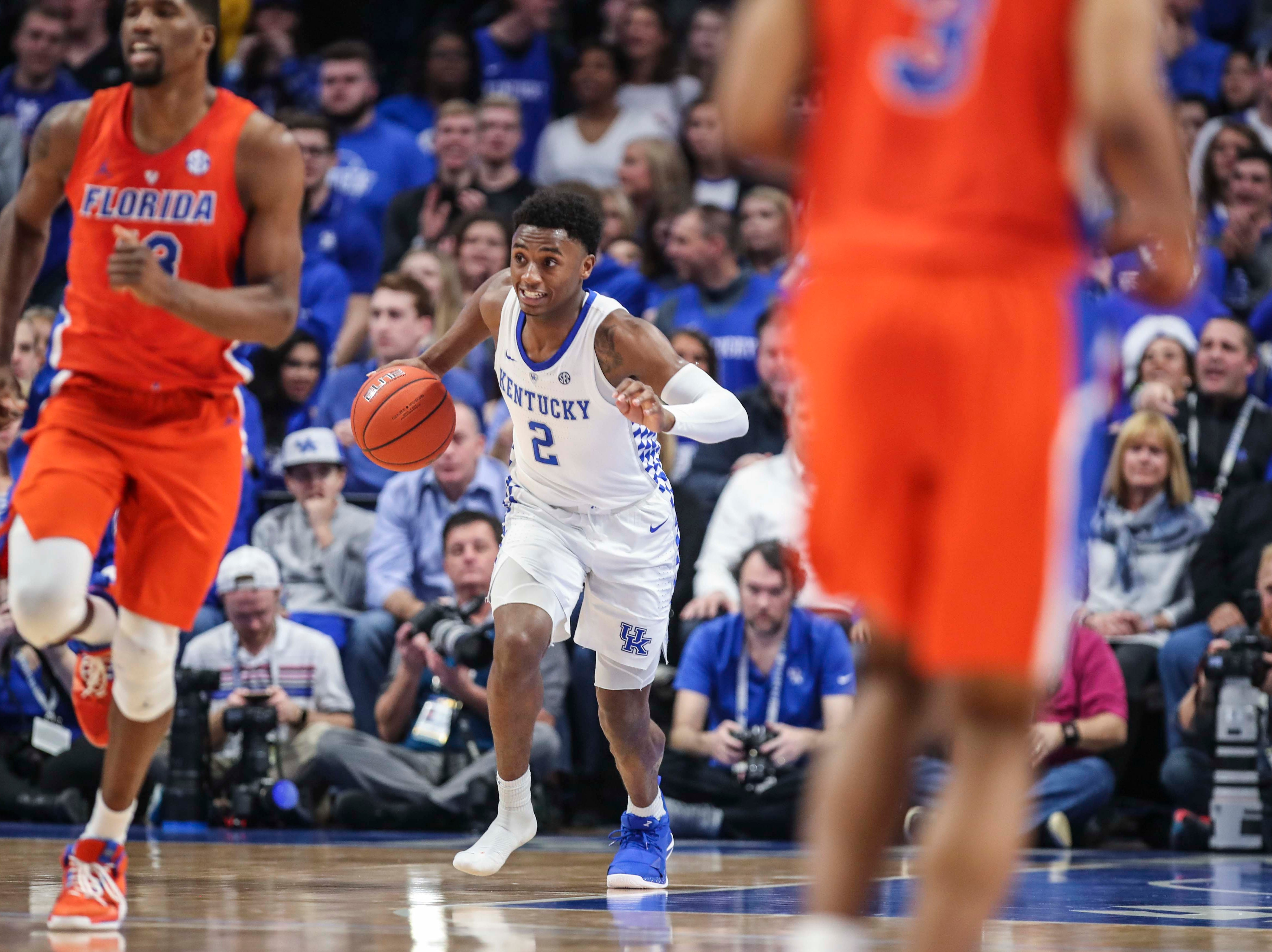 Kentucky's Ashton Hagans heads up the court without a shoe after losing it in the first half against Florida.  March 9, 2019