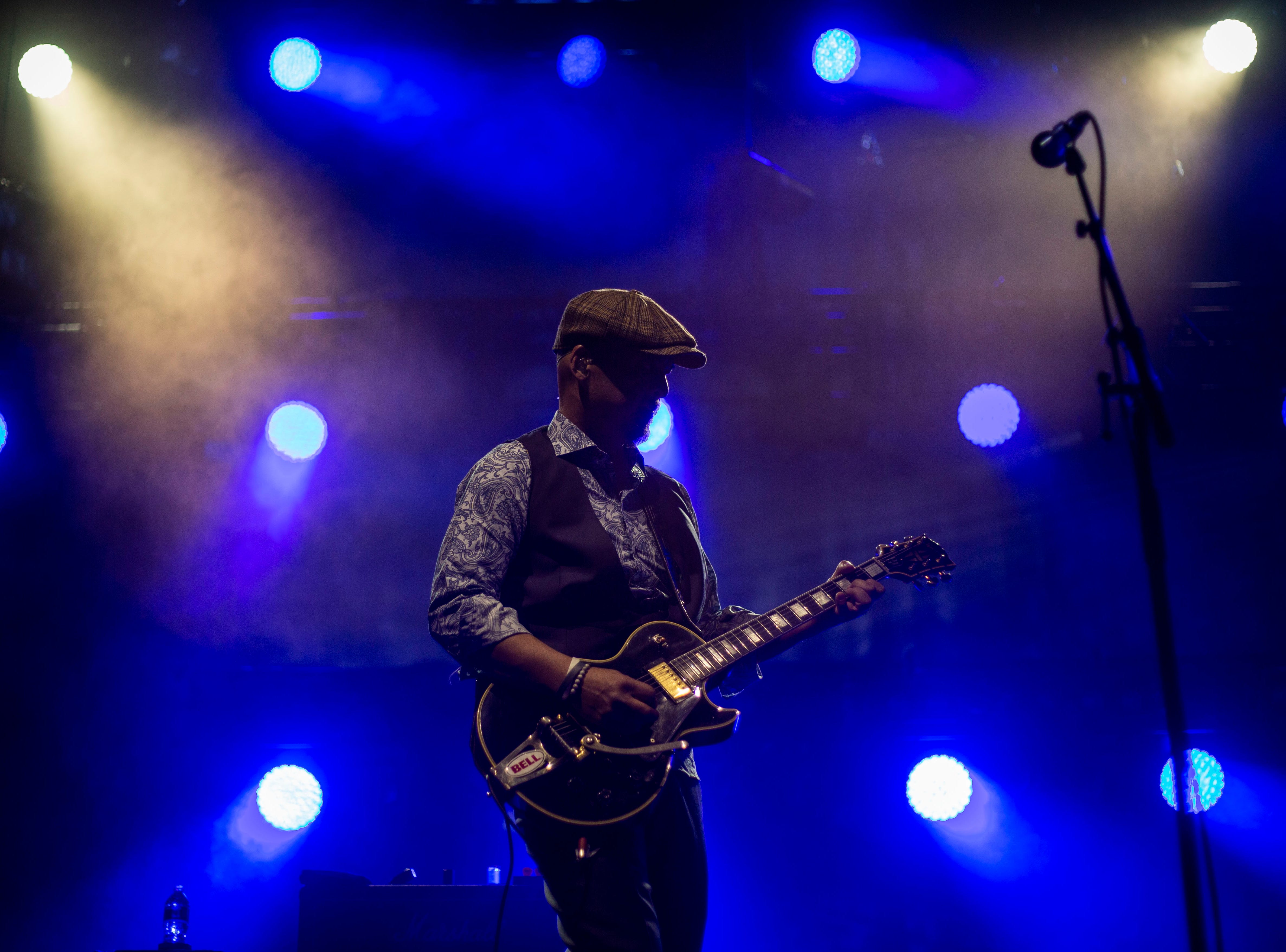 Joey Santiago, guitarist in The Pixies, performs during the first show of the  Weezer x Pixies 2019 tour at the KFC Yum! Center in downtown Louisville, Ky. on Friday, March 8, 2019.