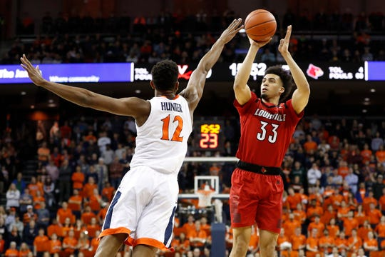 Louisville Cardinals forward Jordan Nwora (33) shoots the ball over Virginia Cavaliers guard De'Andre Hunter (12) in the first half at John Paul Jones Arena in Charlottesville, Virginia, on Saturday, March 9, 2019.
